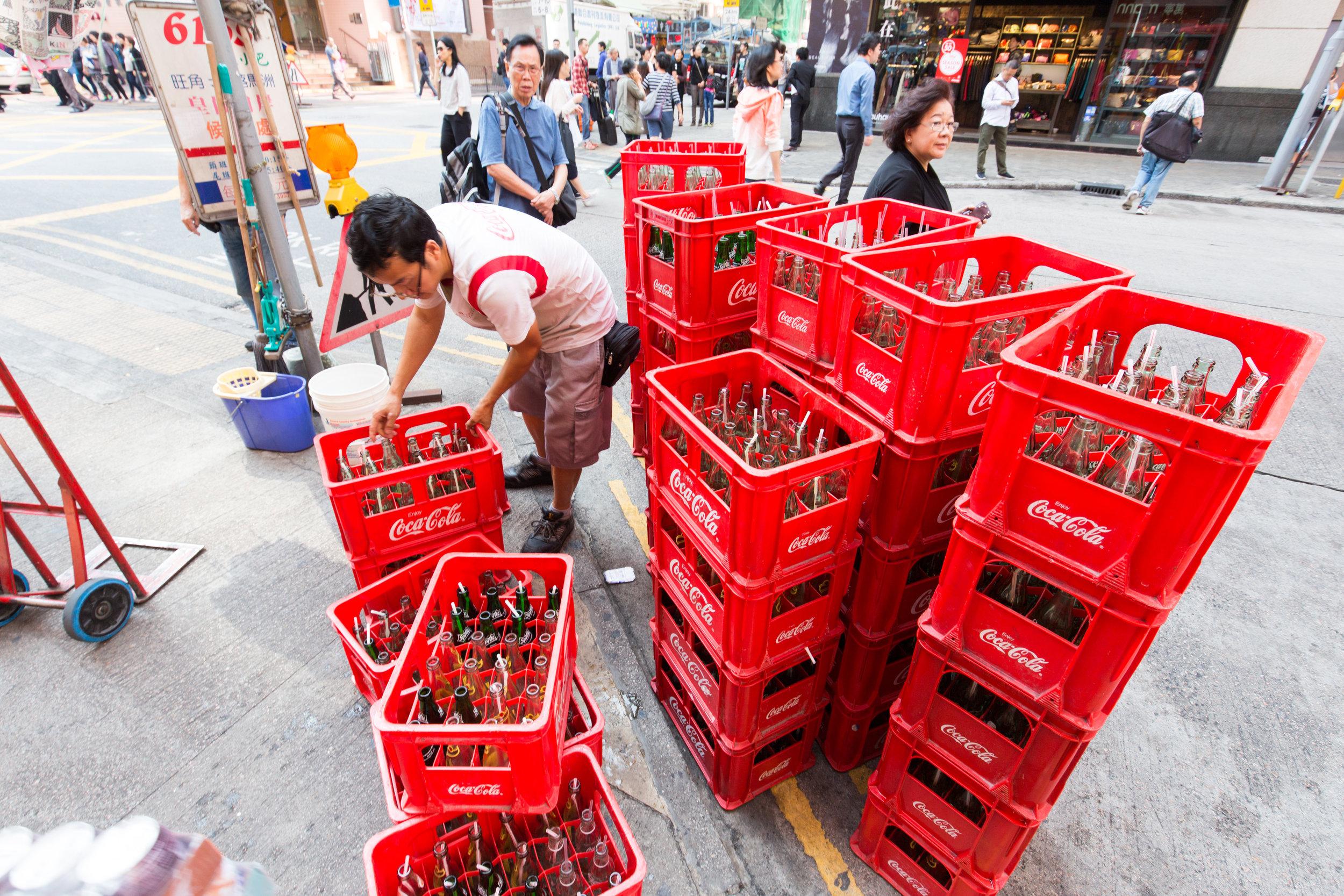 A man picks up empties in Mongkok, Hong Kong