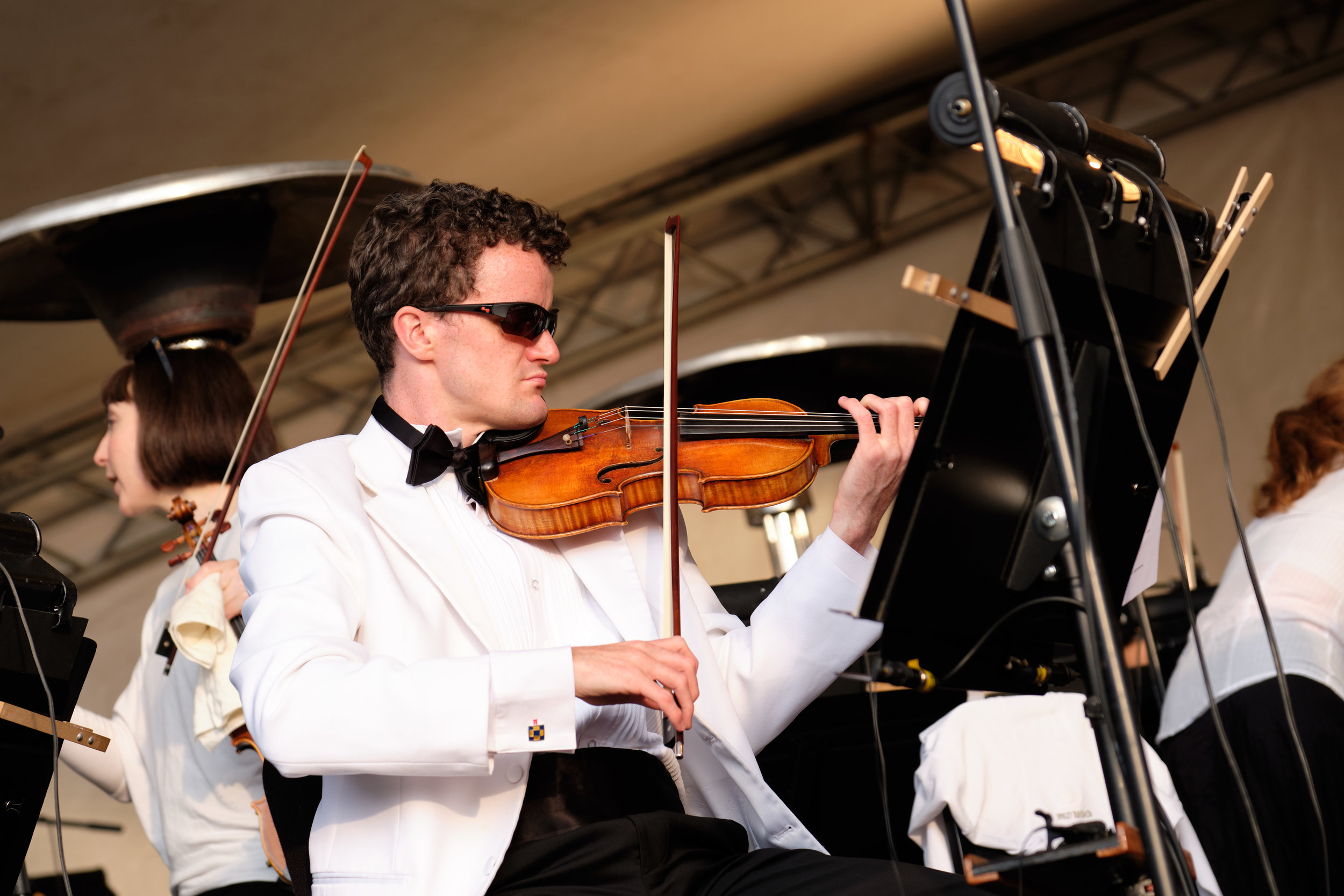 A violinist warms up at the Symphony at Sunset event in Vancouver BC, Canada