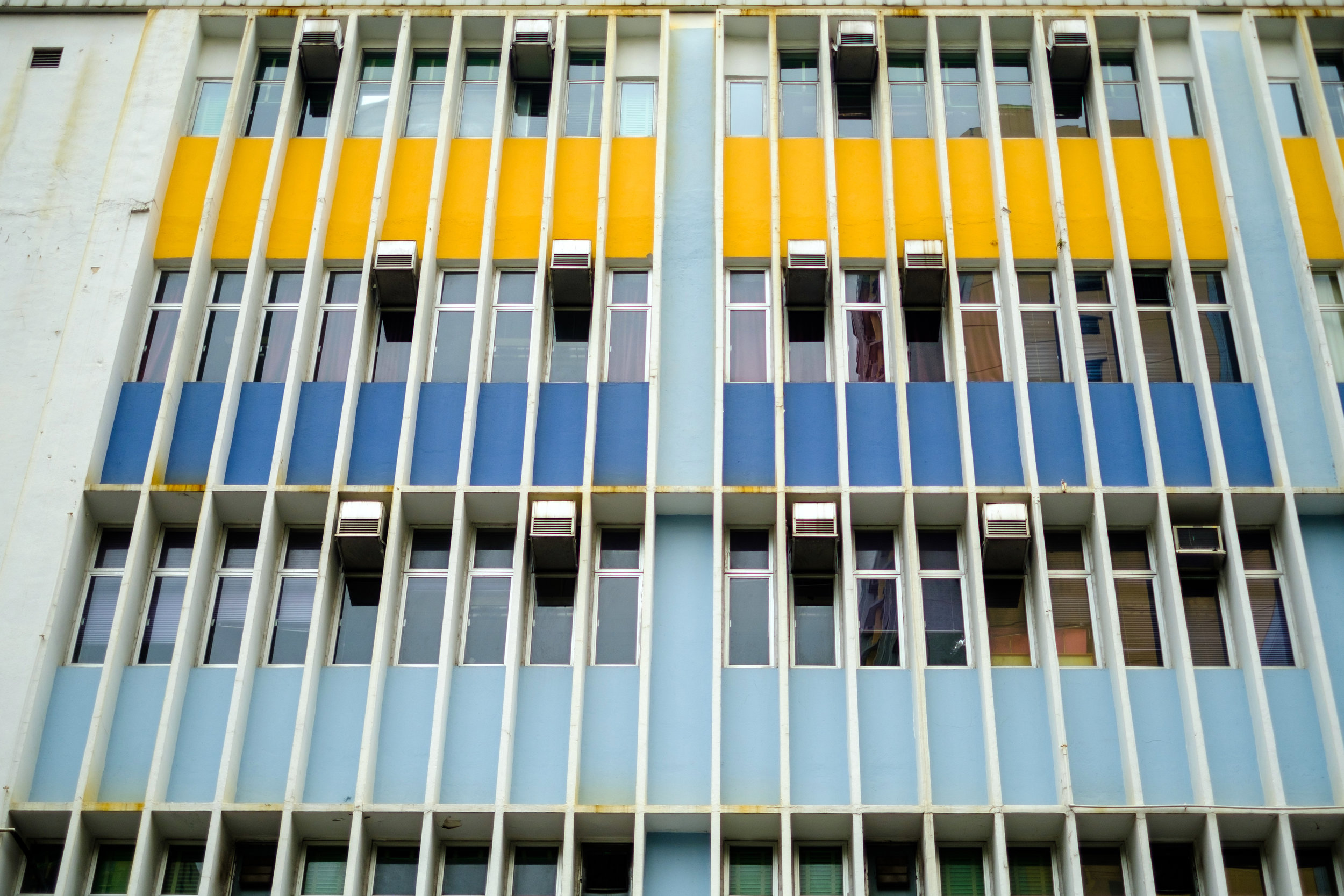 Apartment Building in Kowloon Hong Kong with colourful accent colours