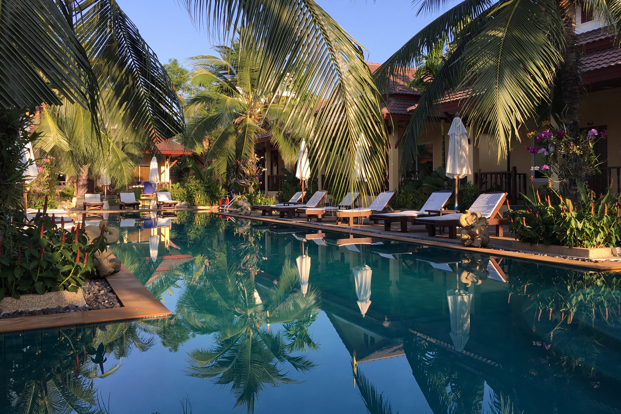 The pool area at Le Piman Resort in Phuket Thailand. A nice option for a morning swim or to hang out with a book after a long day at the beach.
