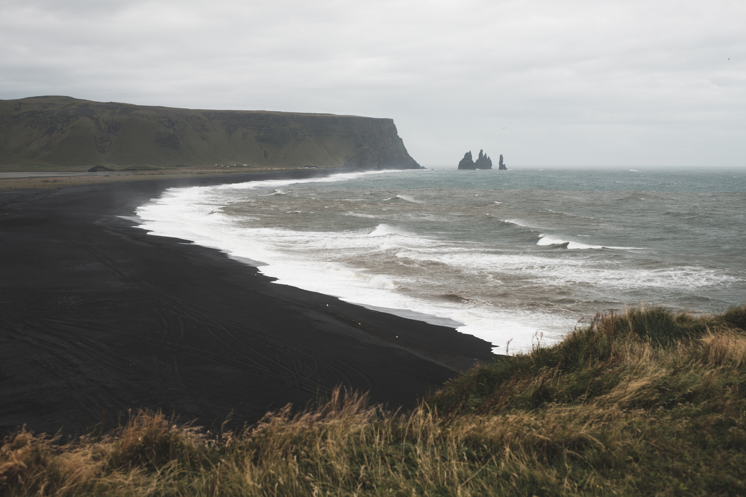 The waves come crashing in on a windy, cloudy, and rainy day at Reynisfjara and the Black Sand Beach.