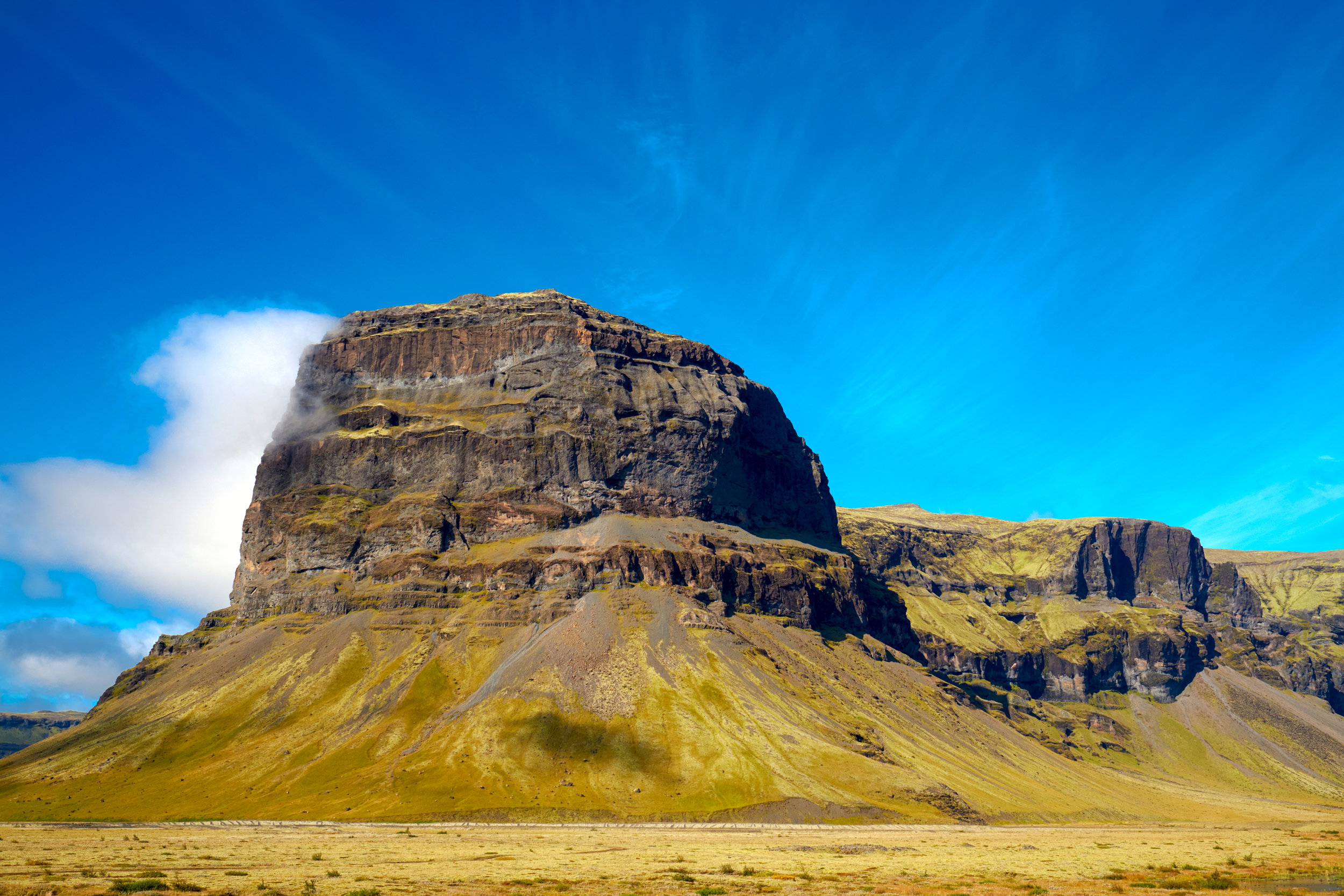 Stunning green landscapes right along Highway 1 in Iceland