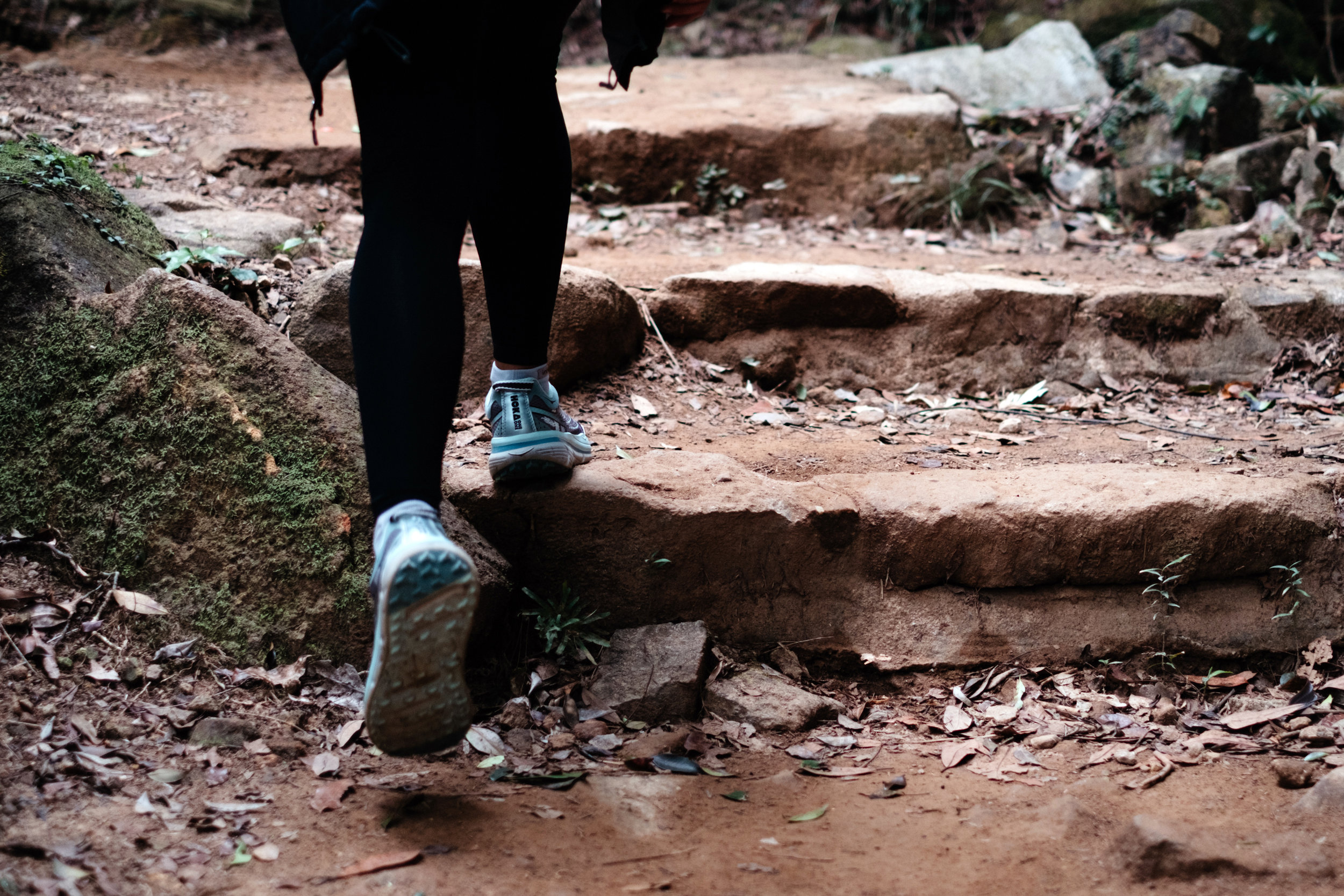 A woman approach the stairs during a hike at the Dragon's Back Trail in Hong Kong