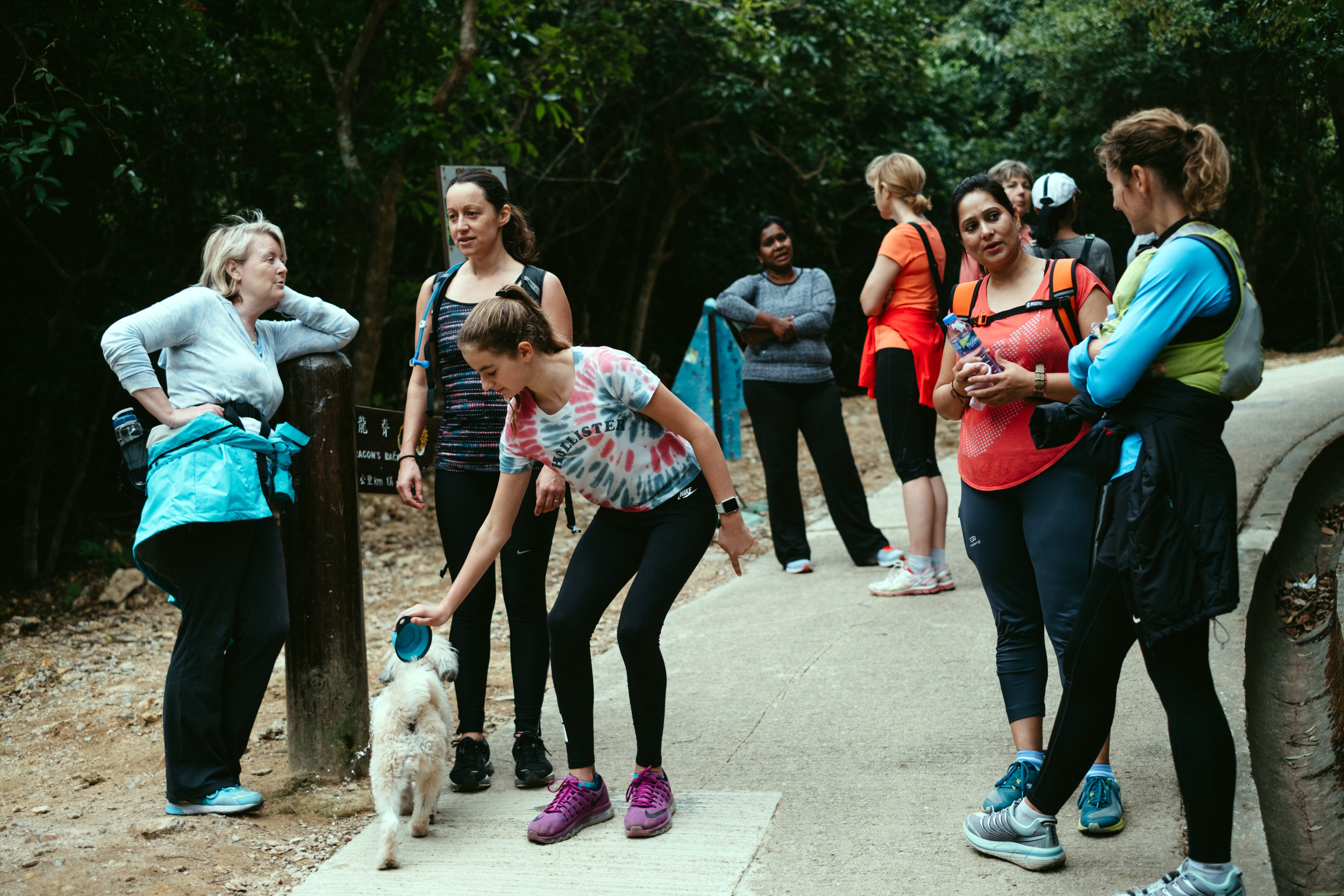 A group of women stops for a rest during a hike at the Dragon's Back Trail in Hong Kong