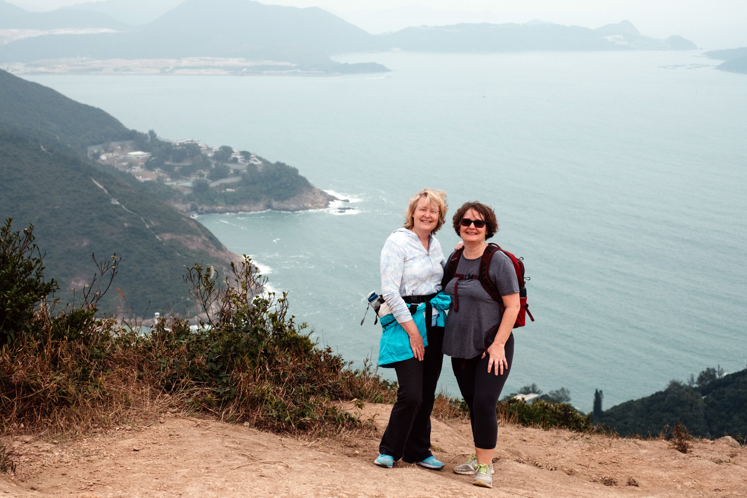 Helen and Diana at the top of the Dragon's Back Trail in Hong Kong