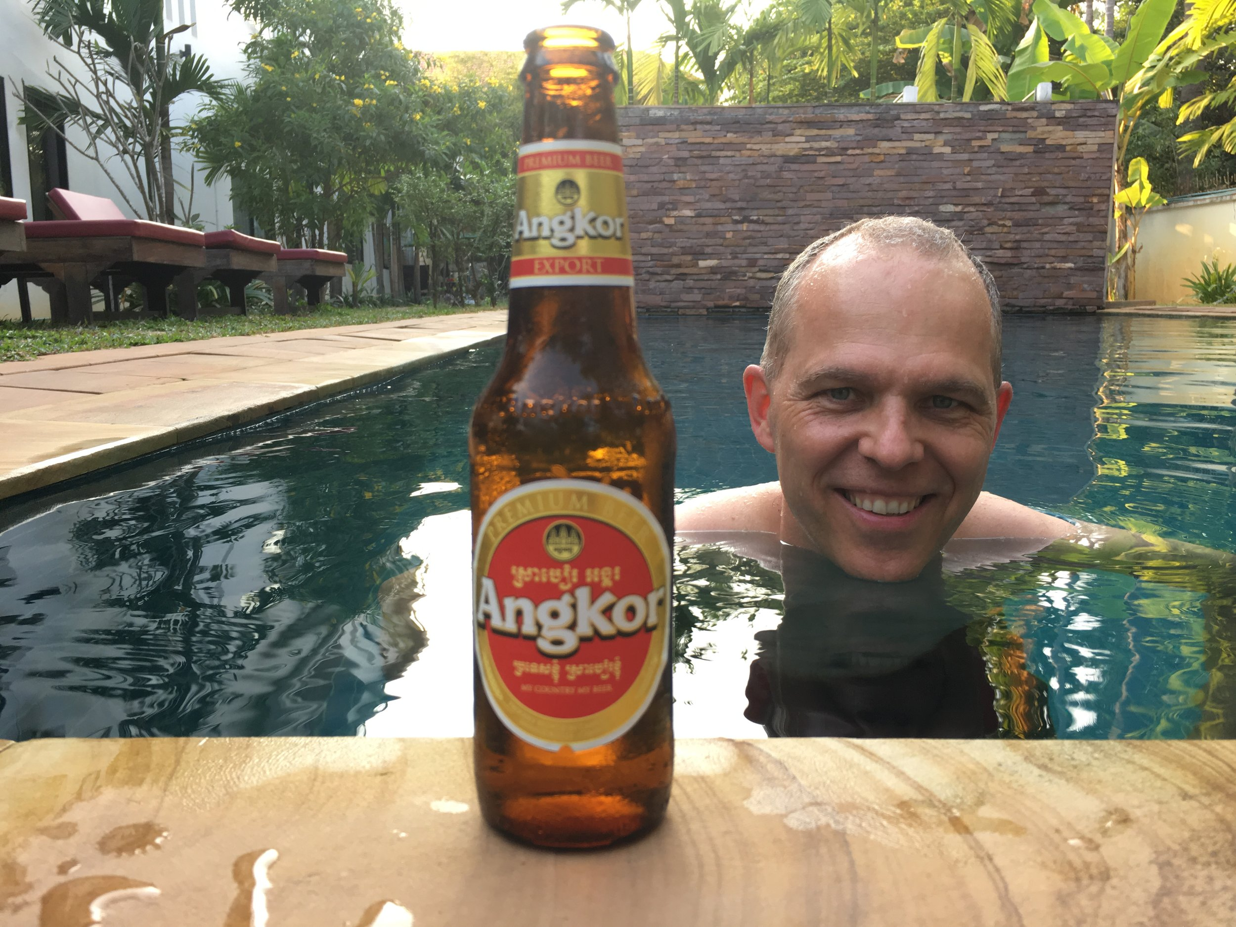 """Adding another Beer to the list of """"Beers From Around the World"""". Enjoying a cold Angkor poolside."""