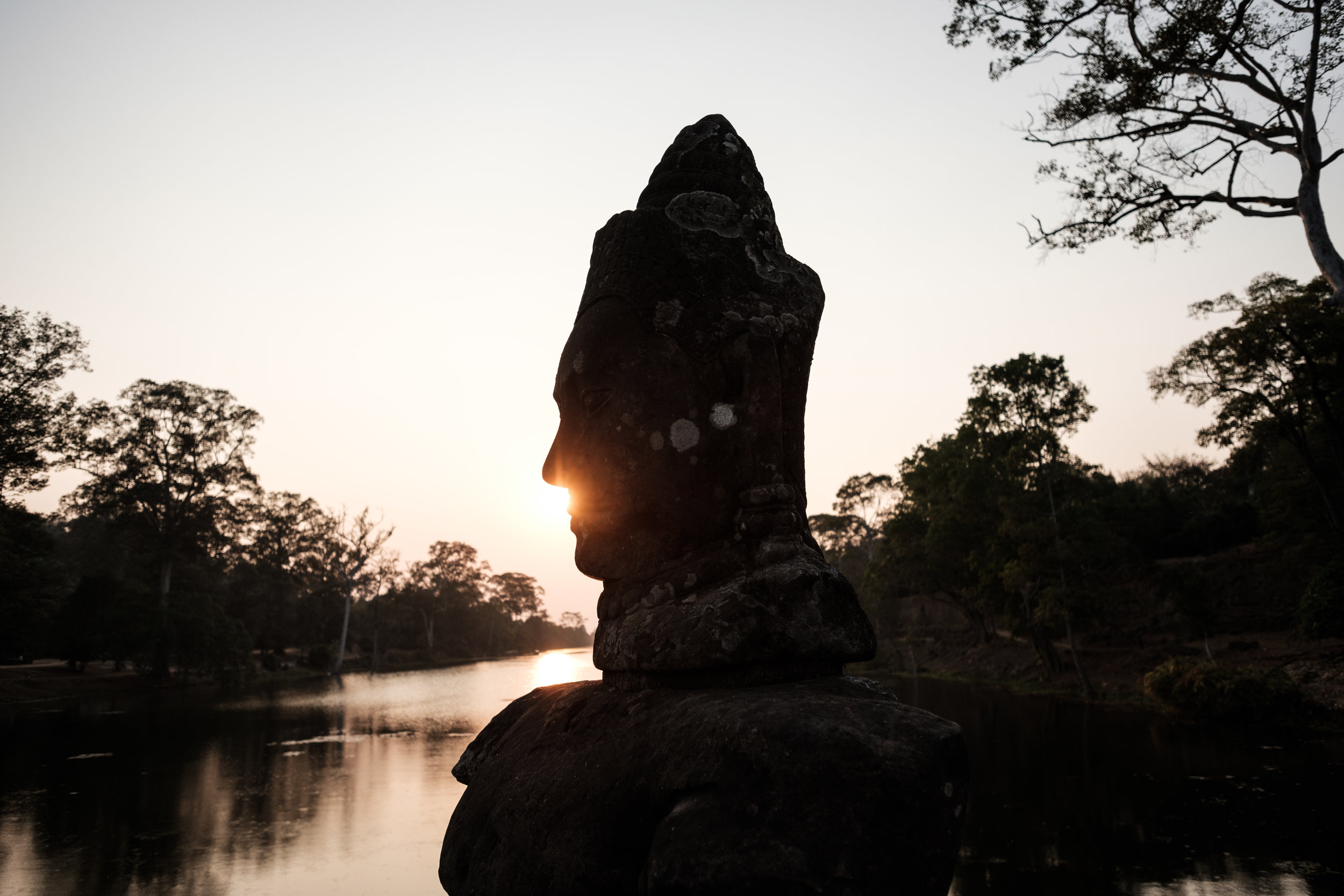 Sunrise by the gate to Angkor Wat