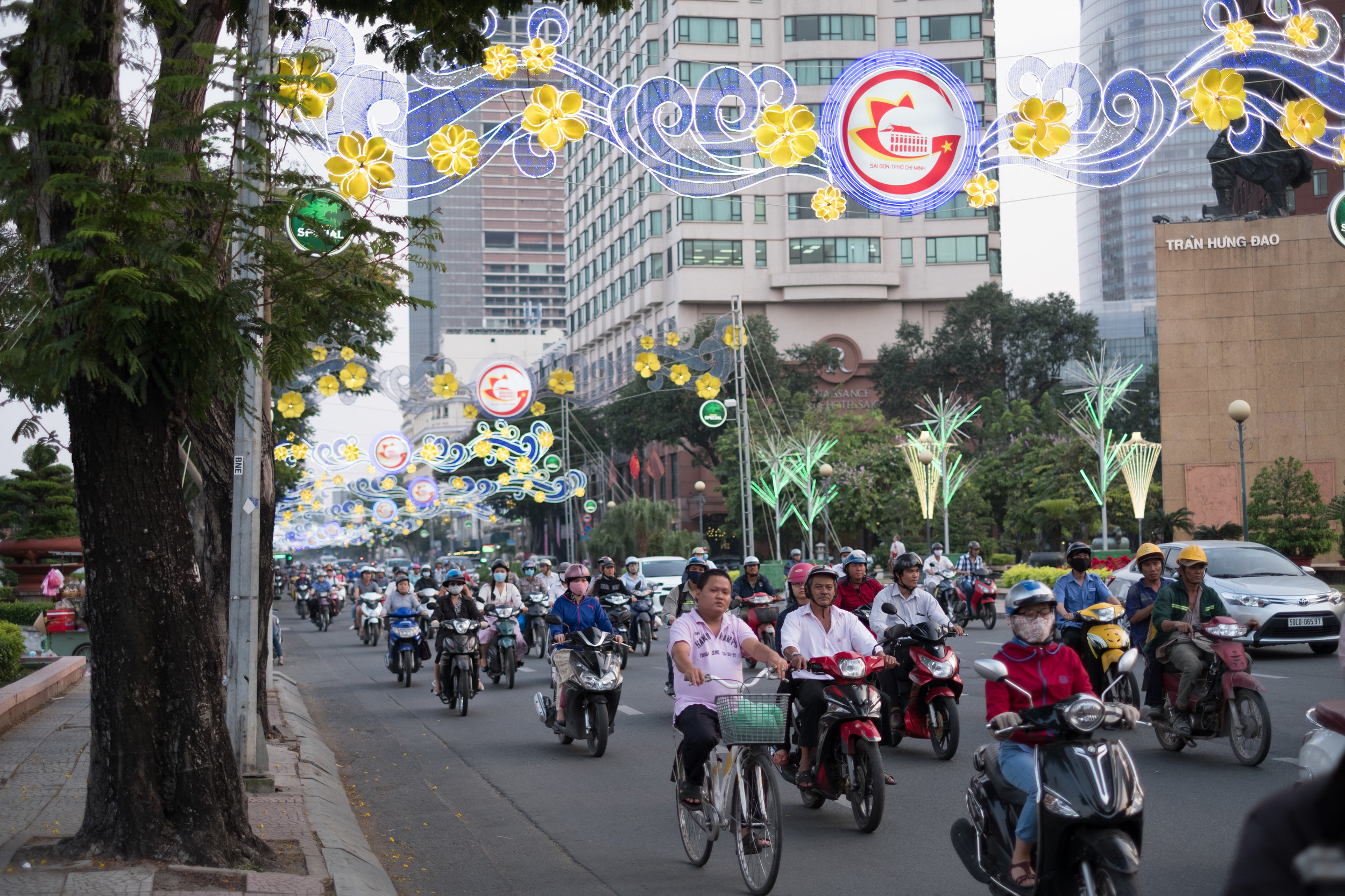 Scooter traffic along a busy road in Ho Chi Minh City in Vietnam