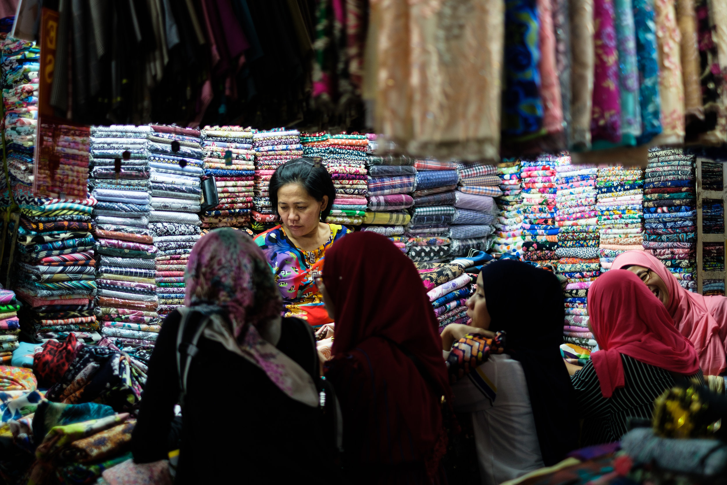 Women shopping for material in Ho Chi Minh Market in Vietnam