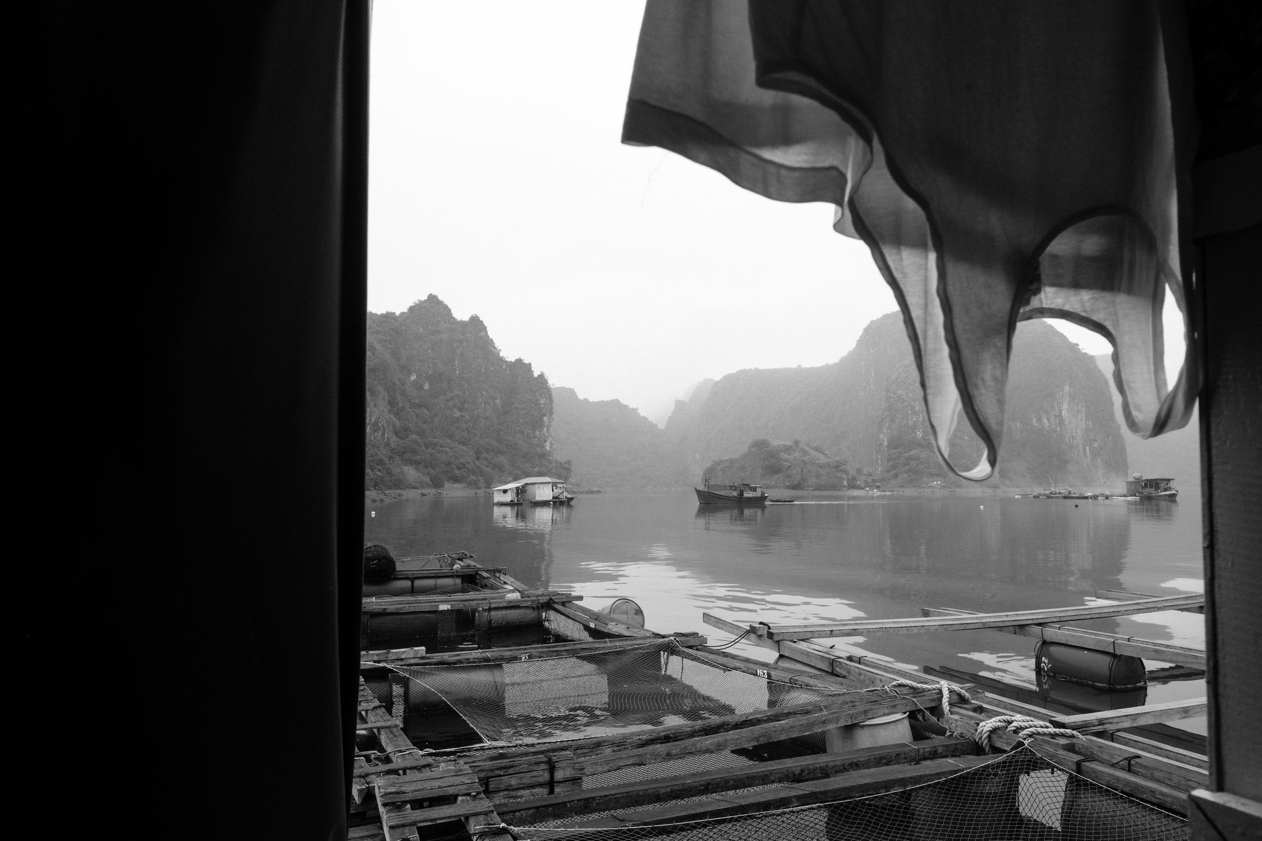 Clothes are hung out to dry in floating fishing village near Cat Ba Island on Lan Ha Bay in Vietnam