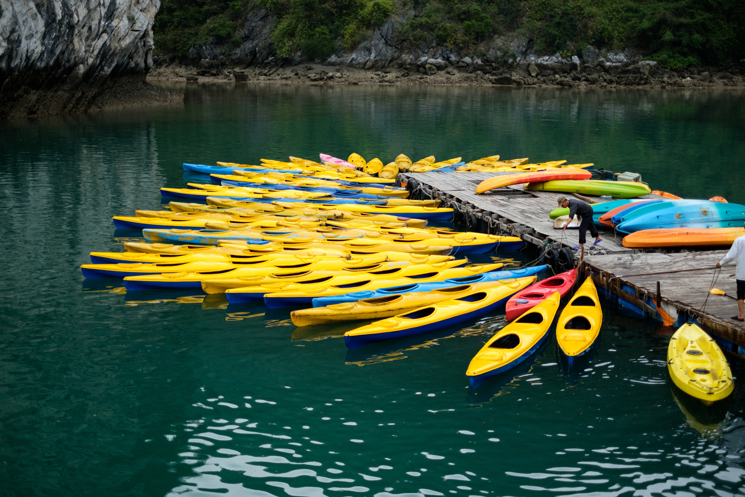 Kayaks are lined up ready for a tour group on Lan Ha Bay in Vietnam