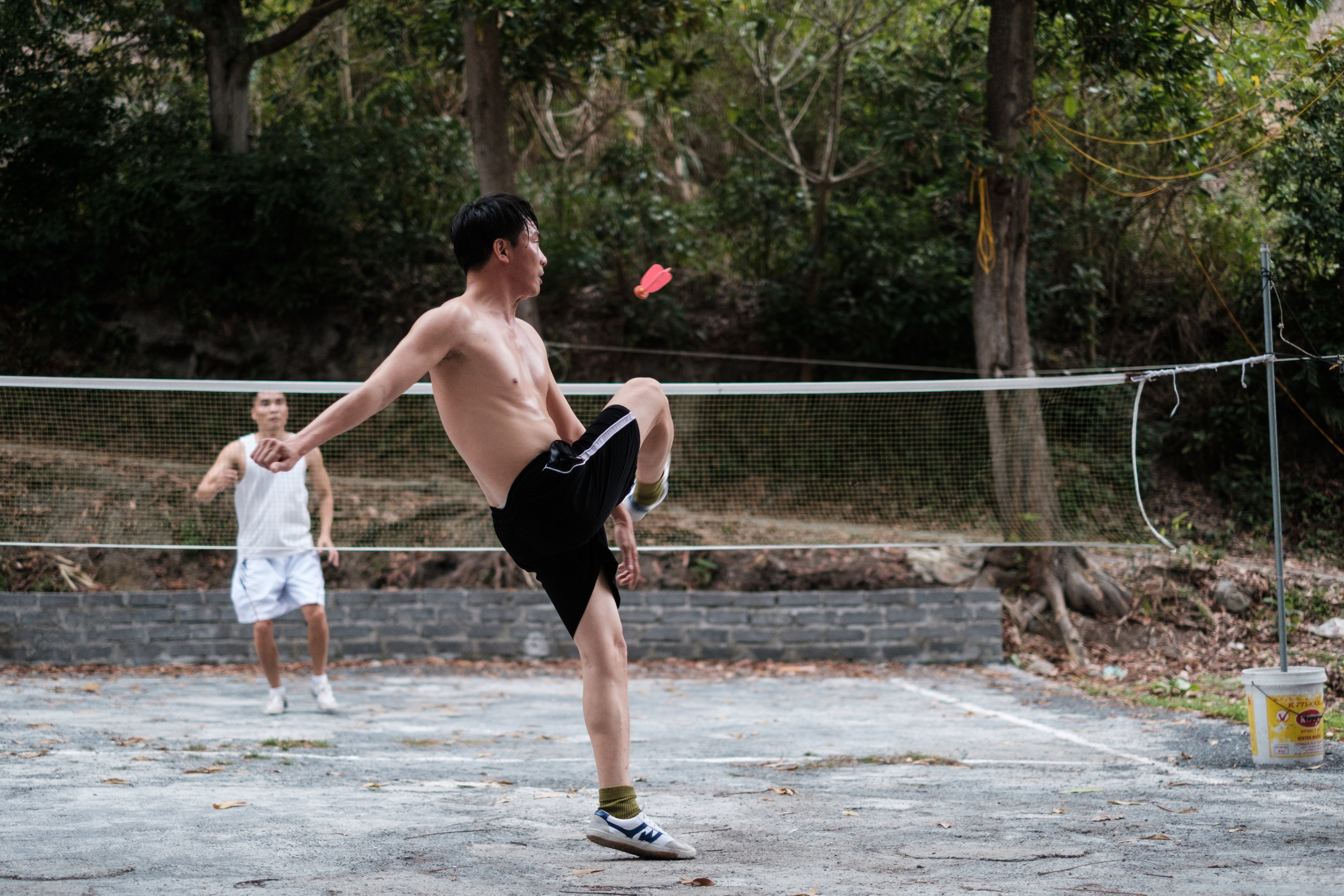 These skilled foot badminton players let me photograph them in action.