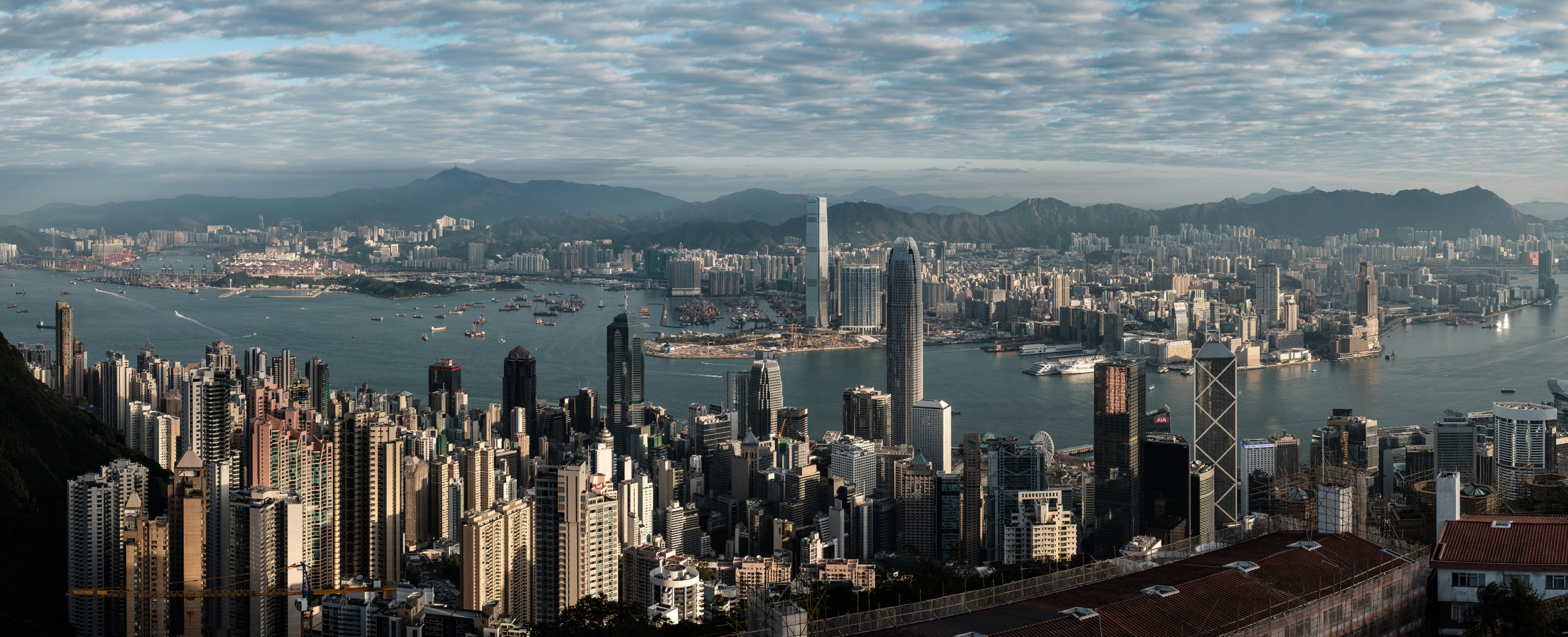 Panoramic view on the Hong Kong Skyline, Kowloon and Victoria Harbour from The Peak.