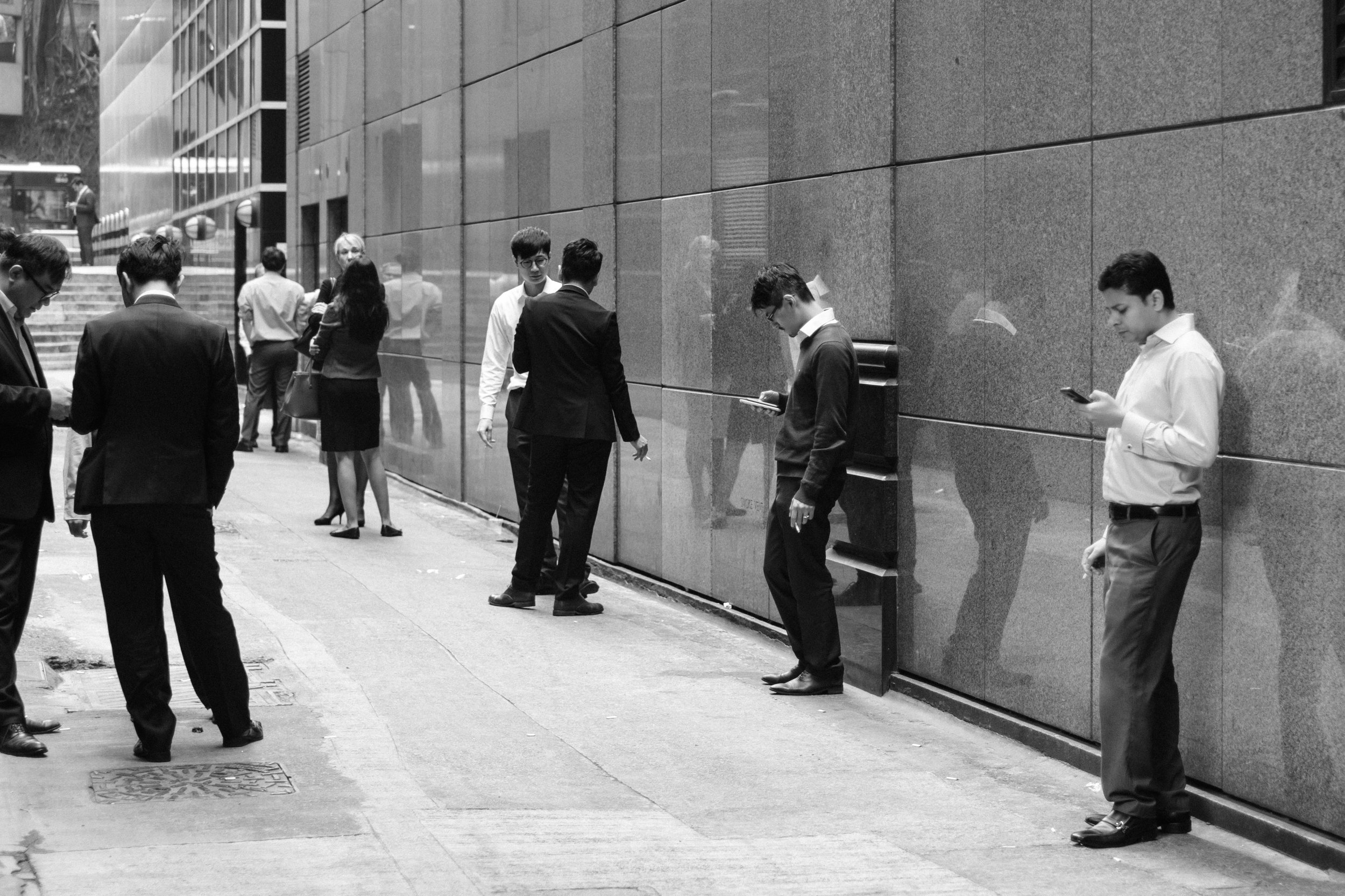 Bank staff on break in Hong Kong Central