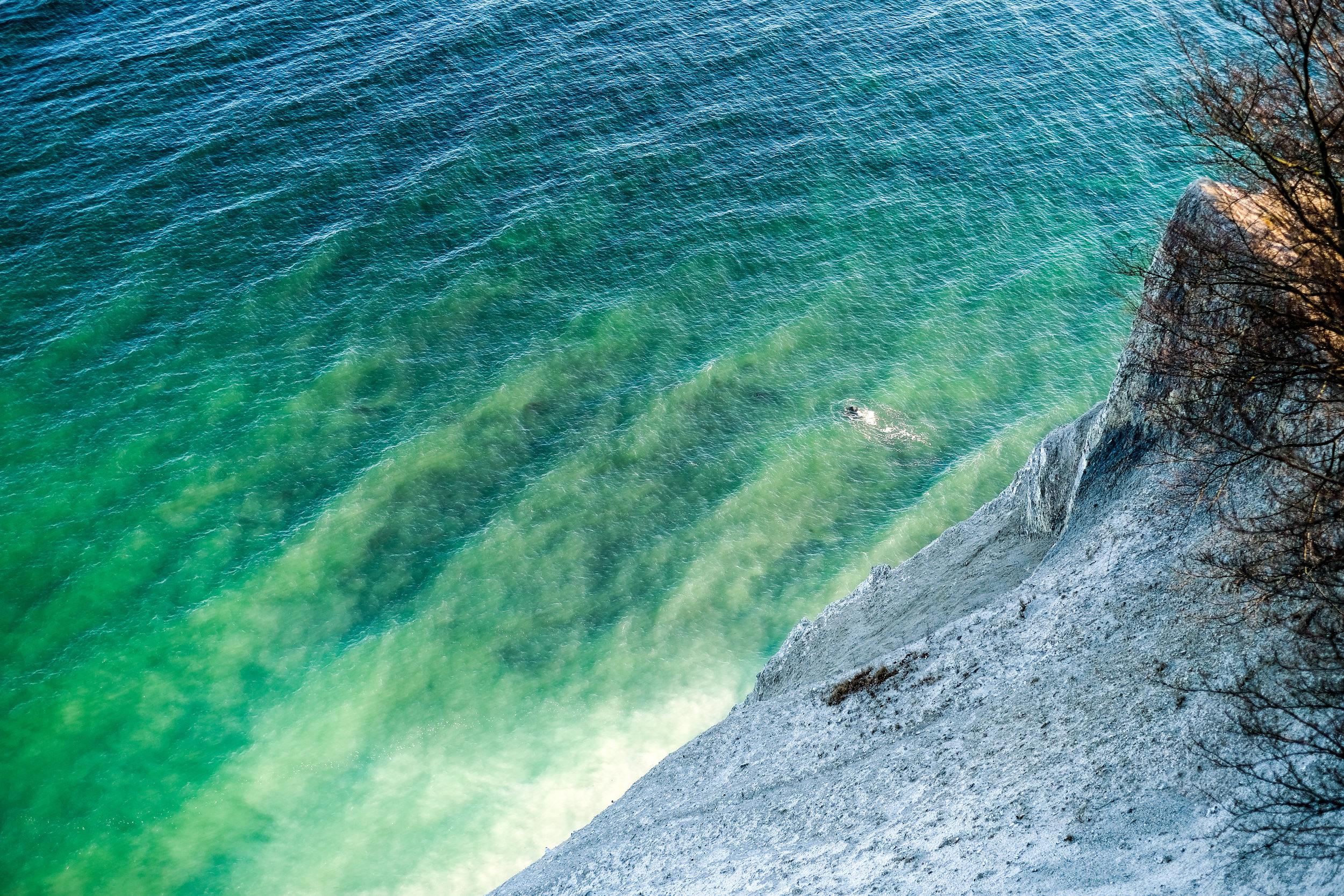 The green water of the Baltic Sea at The Cliffs of Moen, Møns Klint in Denmark