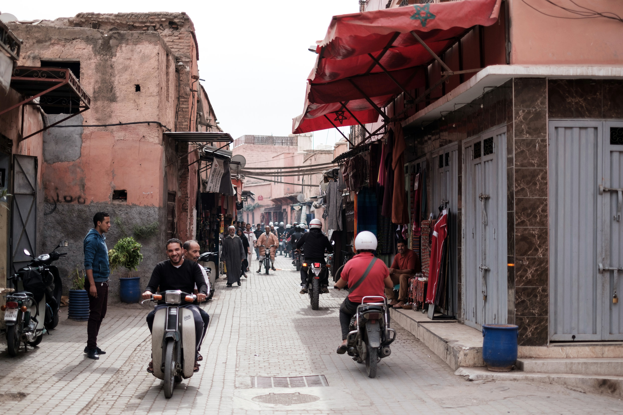 Scooter traffic in the narrow alleys in the Medina District