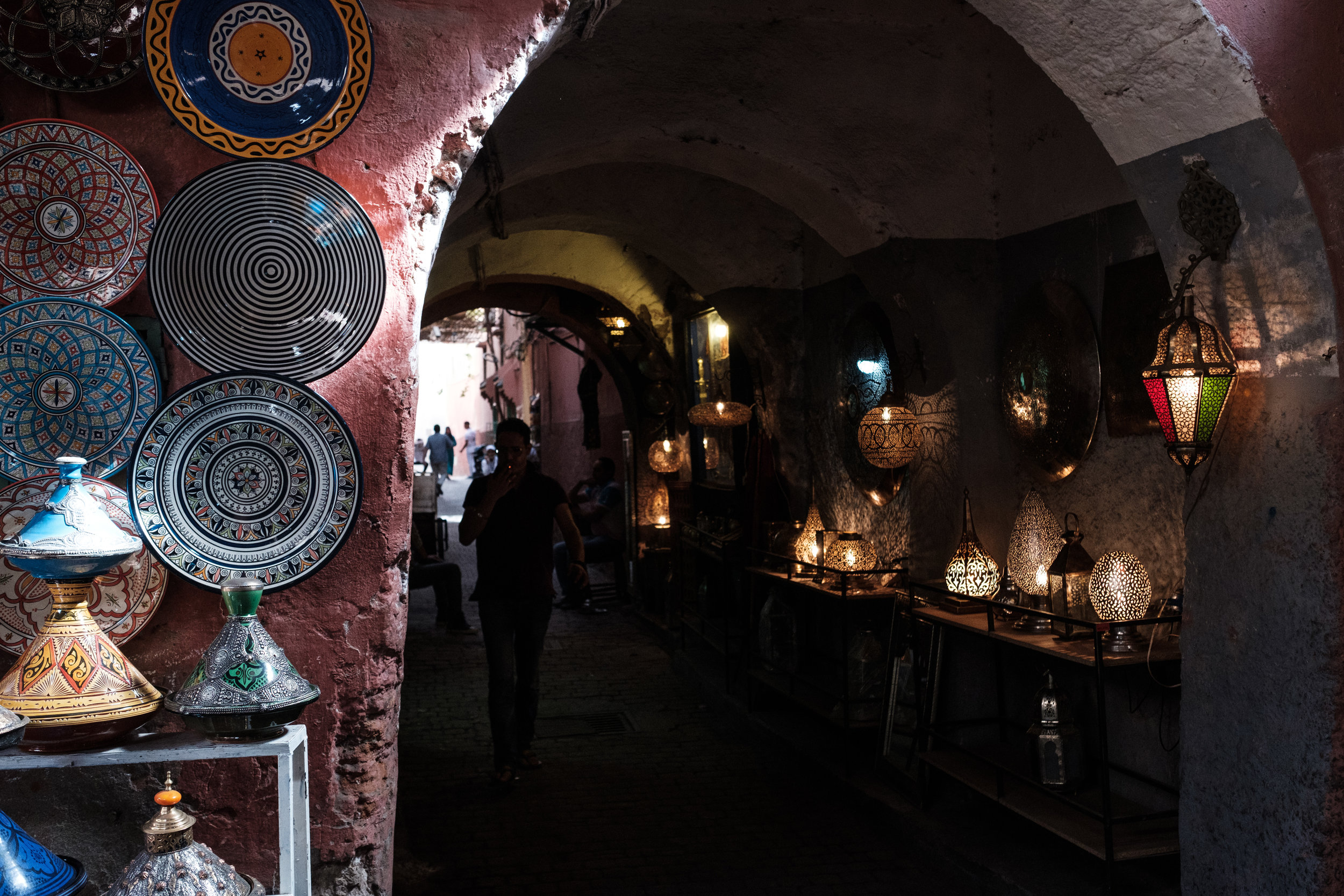 Moroccan pottery and lamps on display.