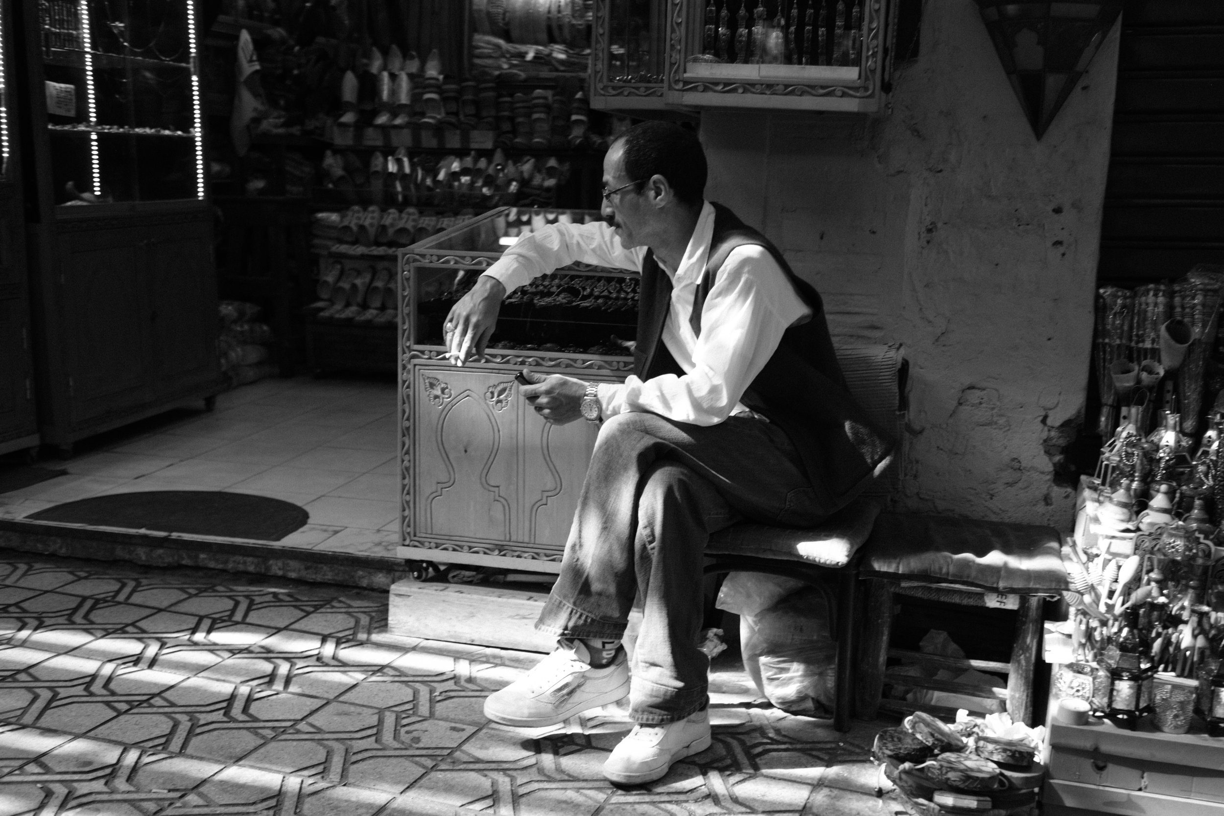 A man tends to his store in a Medina District Souk in Marrakech Morocco