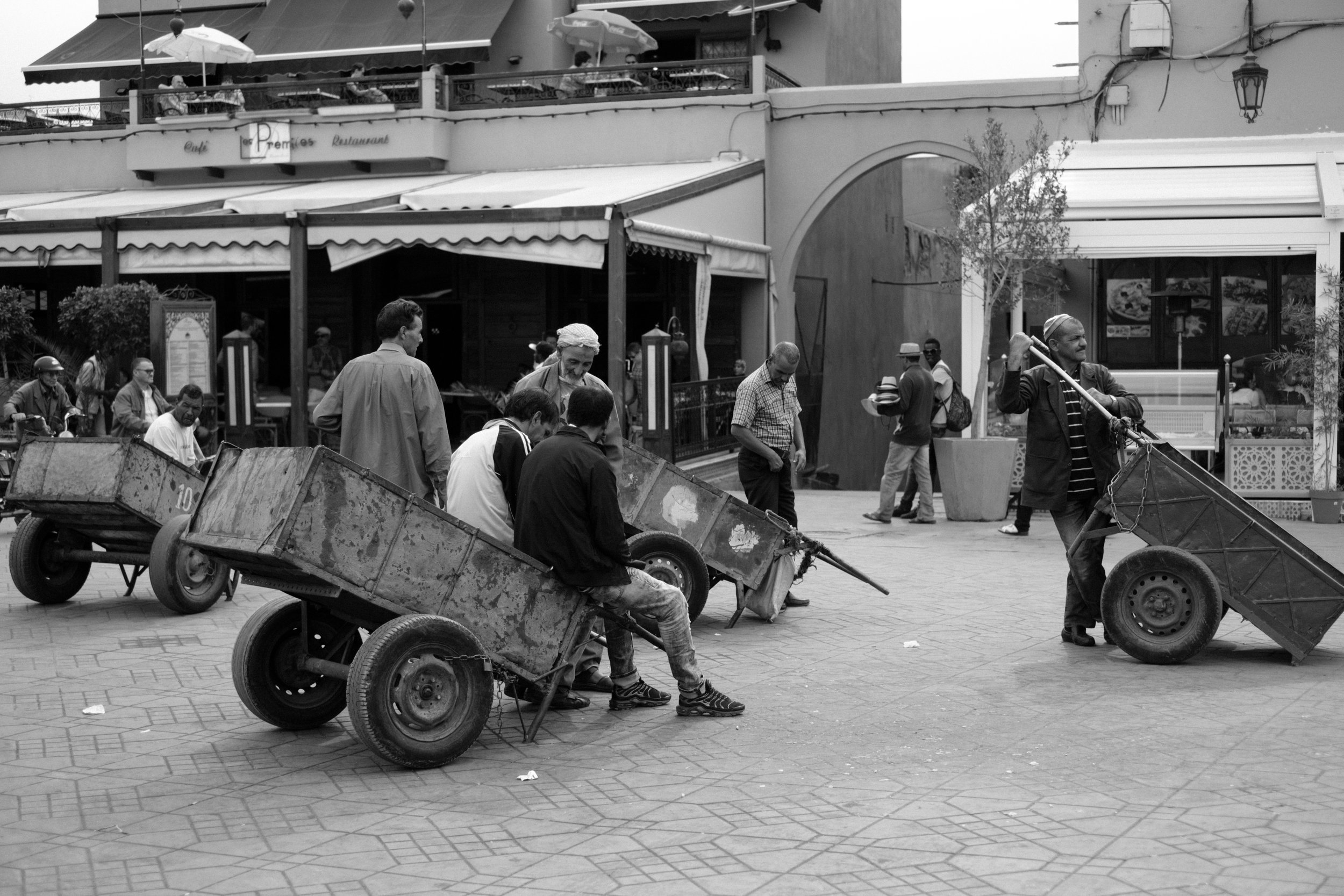 Men are lined up and ready for work at Jemaa el-Fna Square in Marrakech Morocco