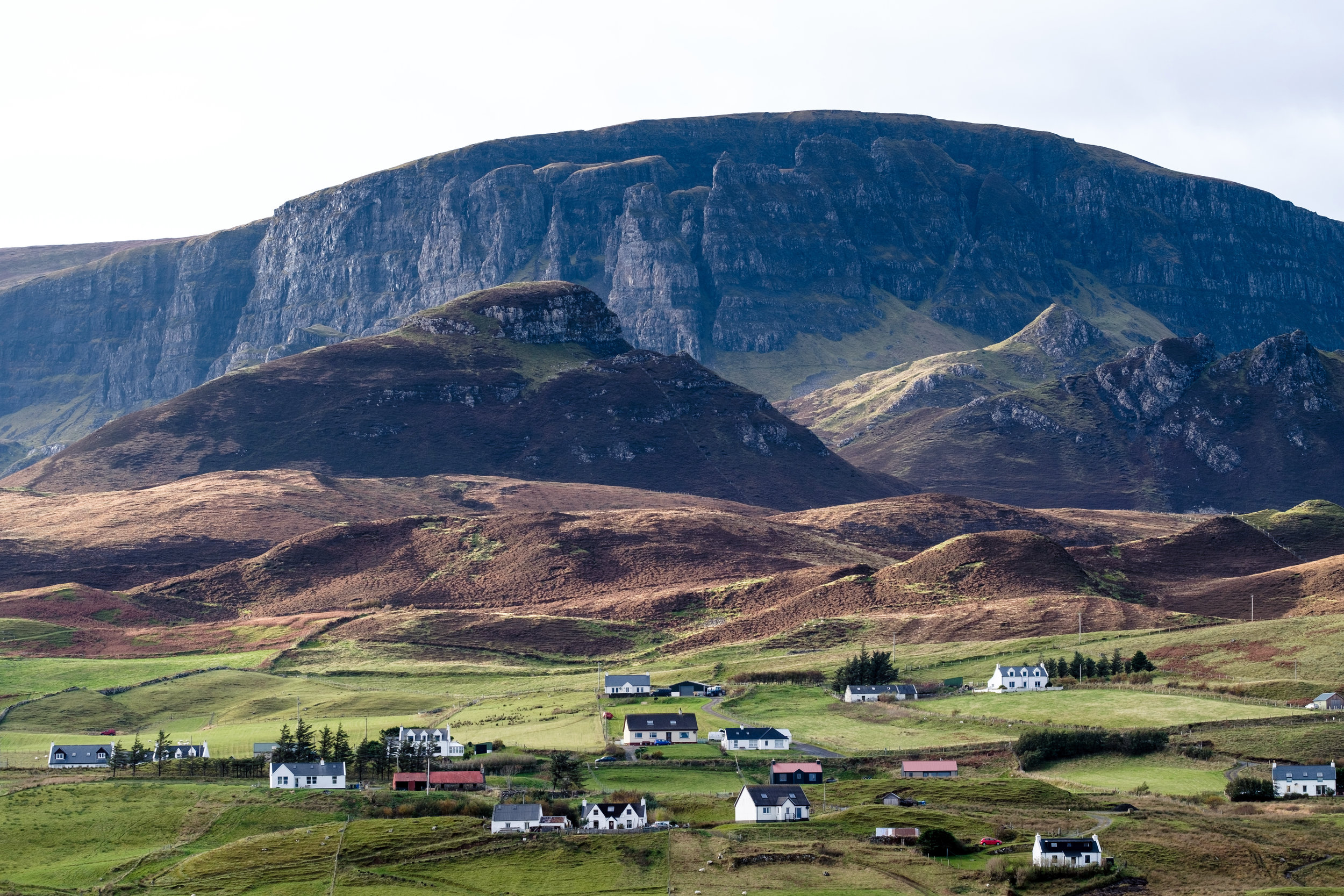 Village and the green hillsides on Isle of Skye in Scotland