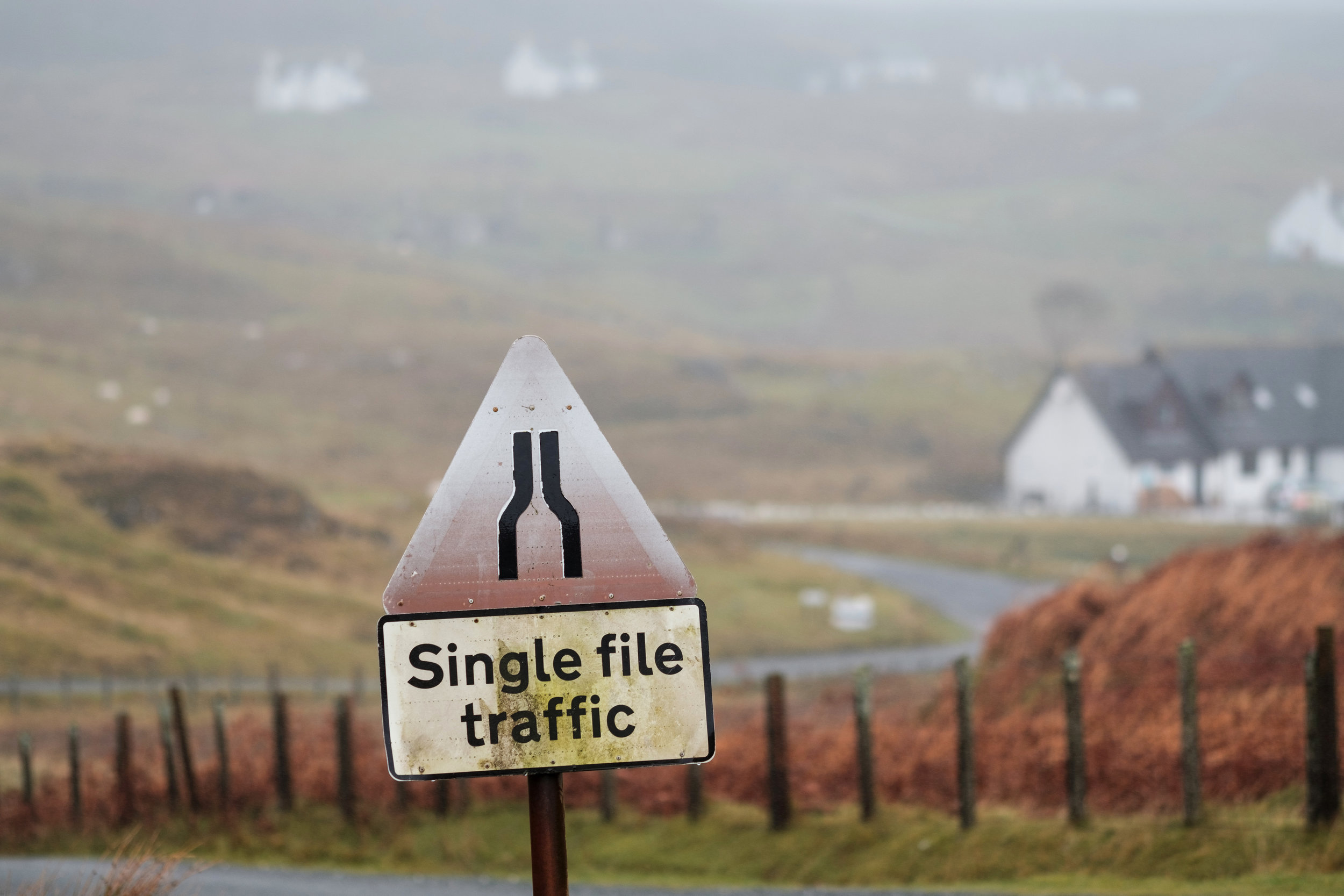 Traffic sign on Isle of Skye, Single Line Traffic only and the winding road in Scotland
