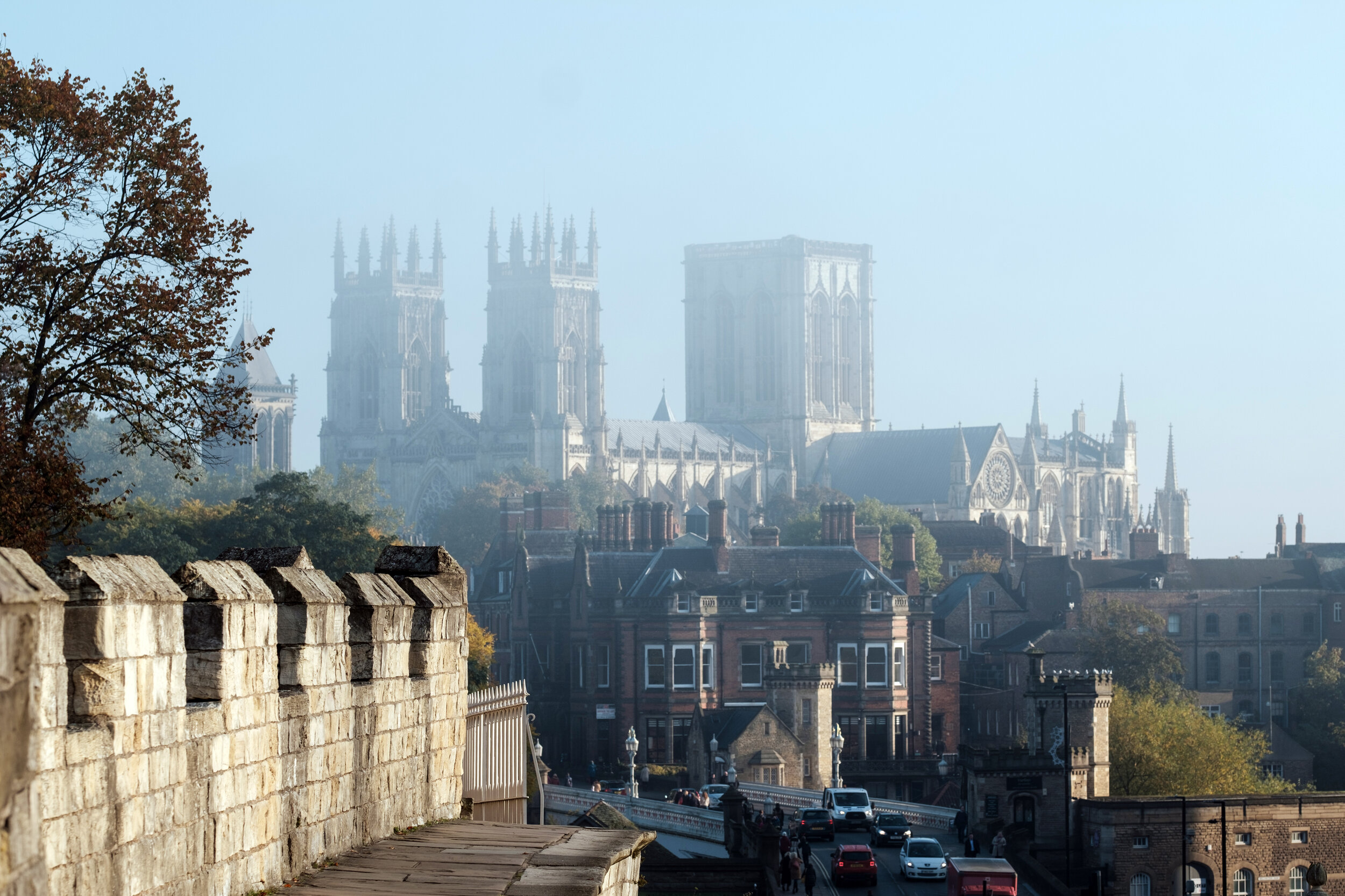 York minster and the historic walls on an early misty fall morning in England