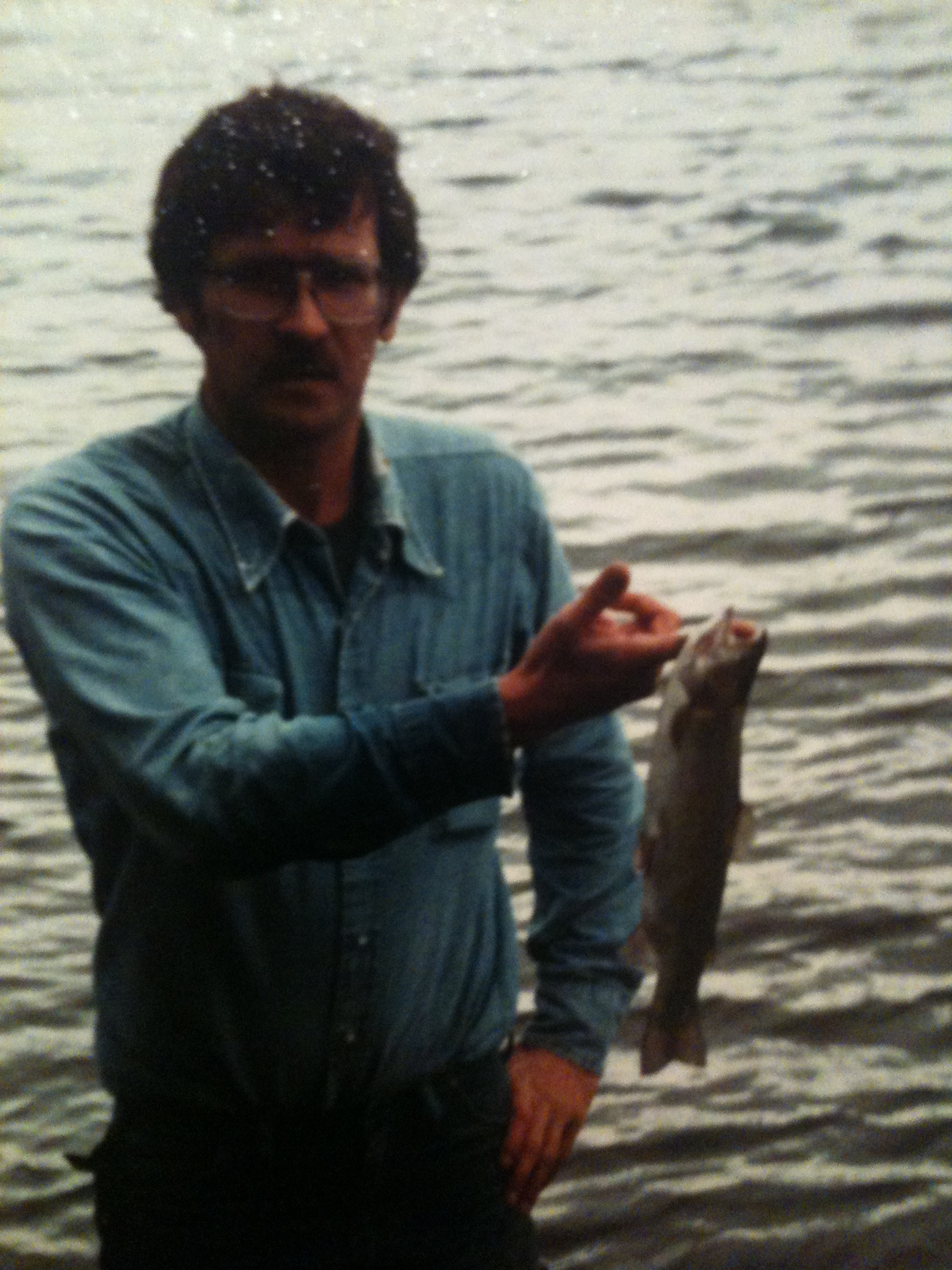 my uncle, Scott, showing off a catch