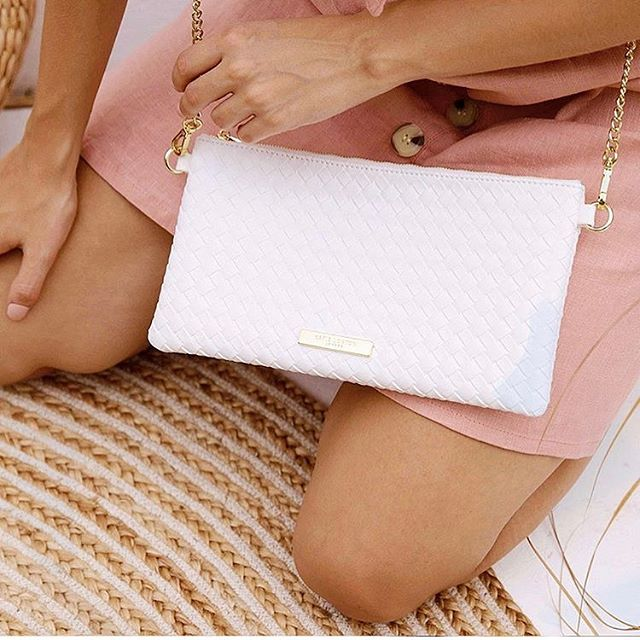 Woven leather, with a removable gold chain strap; the perfect little day to night bag for summer!💗