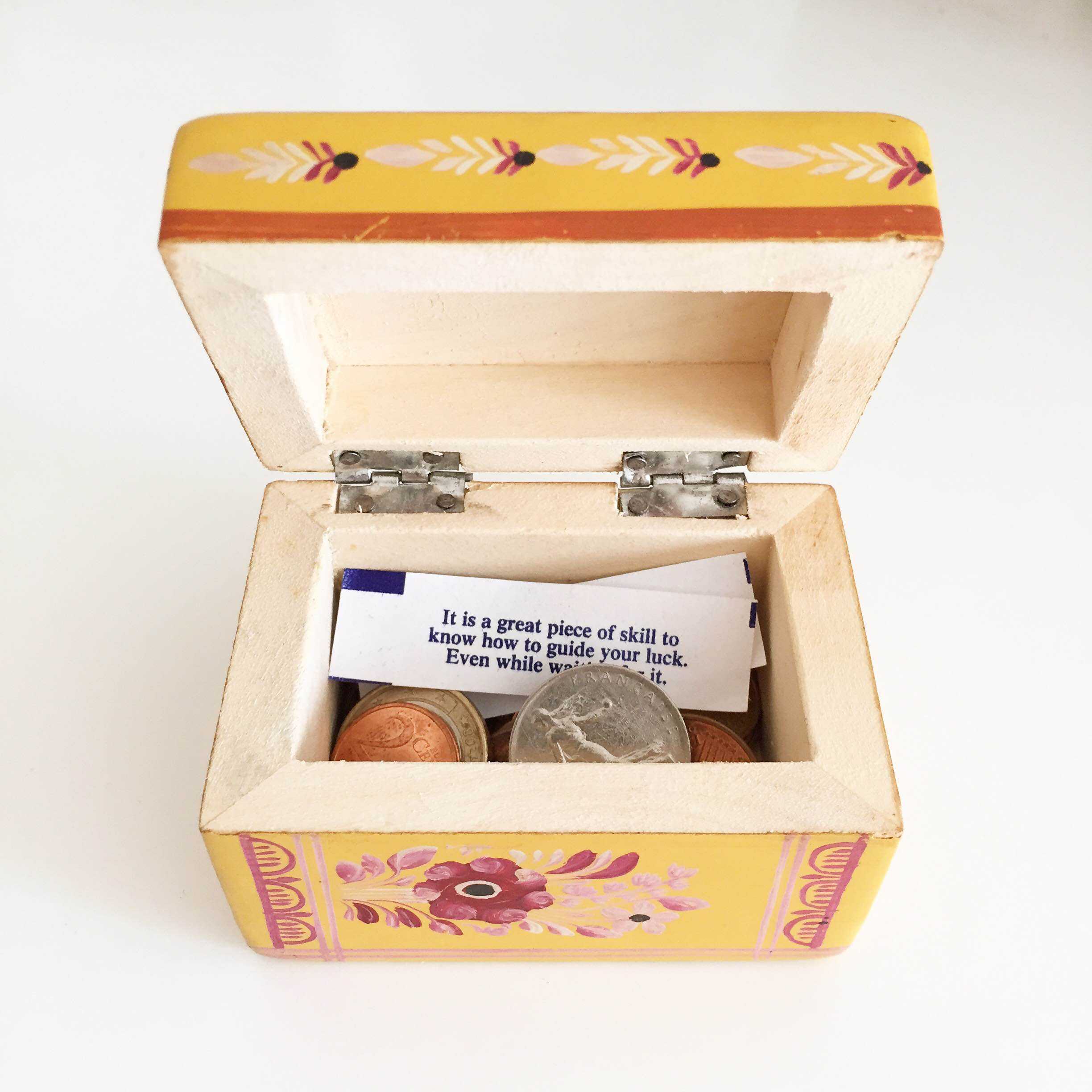 Small boxes make for good organizers (and surprises). I opened this one recently to find some spare Euros (handy, since I was traveling to Italy), an old Franc (quite the relic!) and a sweet fortune with poignant advice.