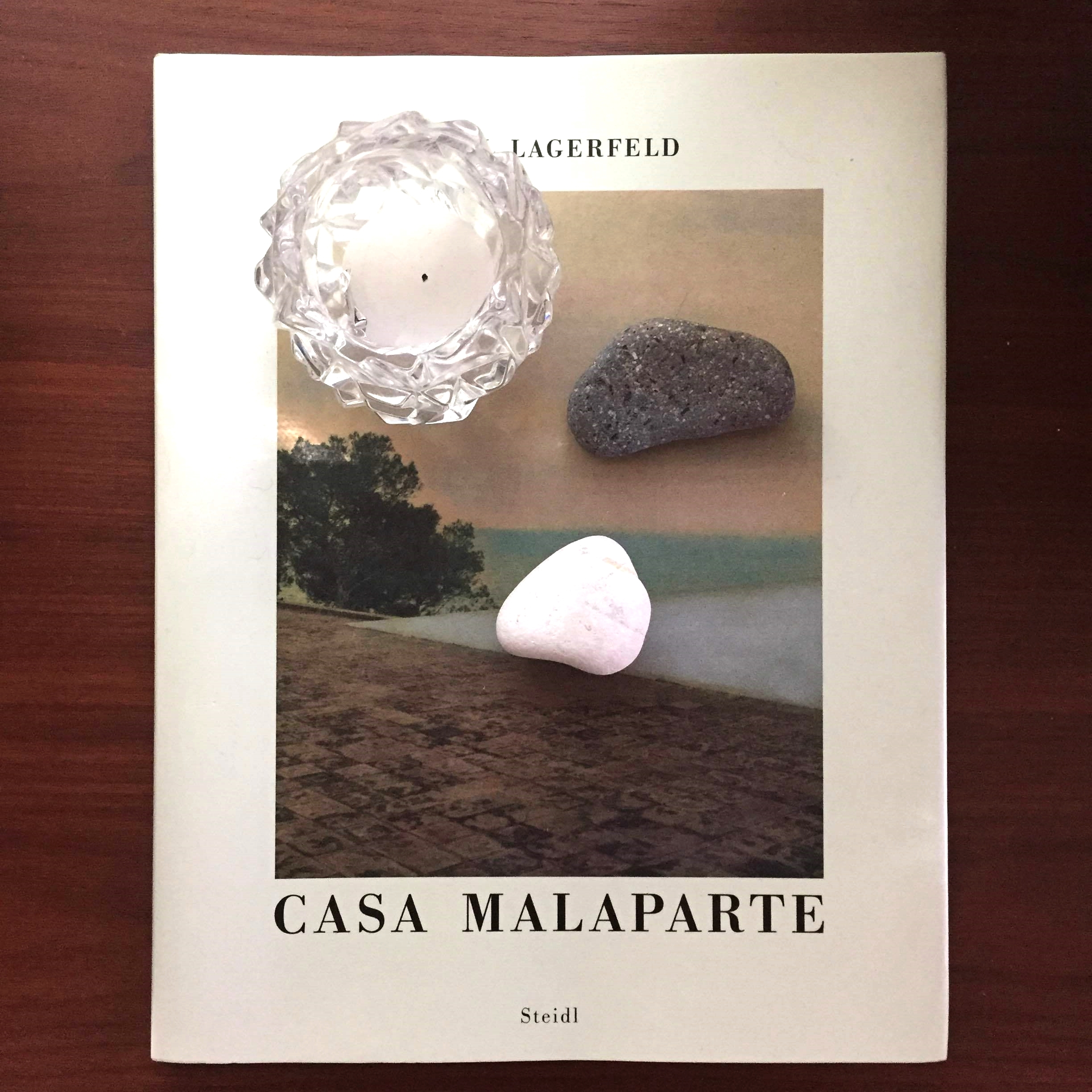 Seeing Casa Malaparte in Capri was an ultimate architectural moment for me. Year's later, I bought Karl Lagerfeld's  photo essay  on the house as a memory. It's displayed on a console,topped by rocks we picked up on the shore of another Italian island,Lisca Bianca. The  Tiffany  candleholder was a wedding present.