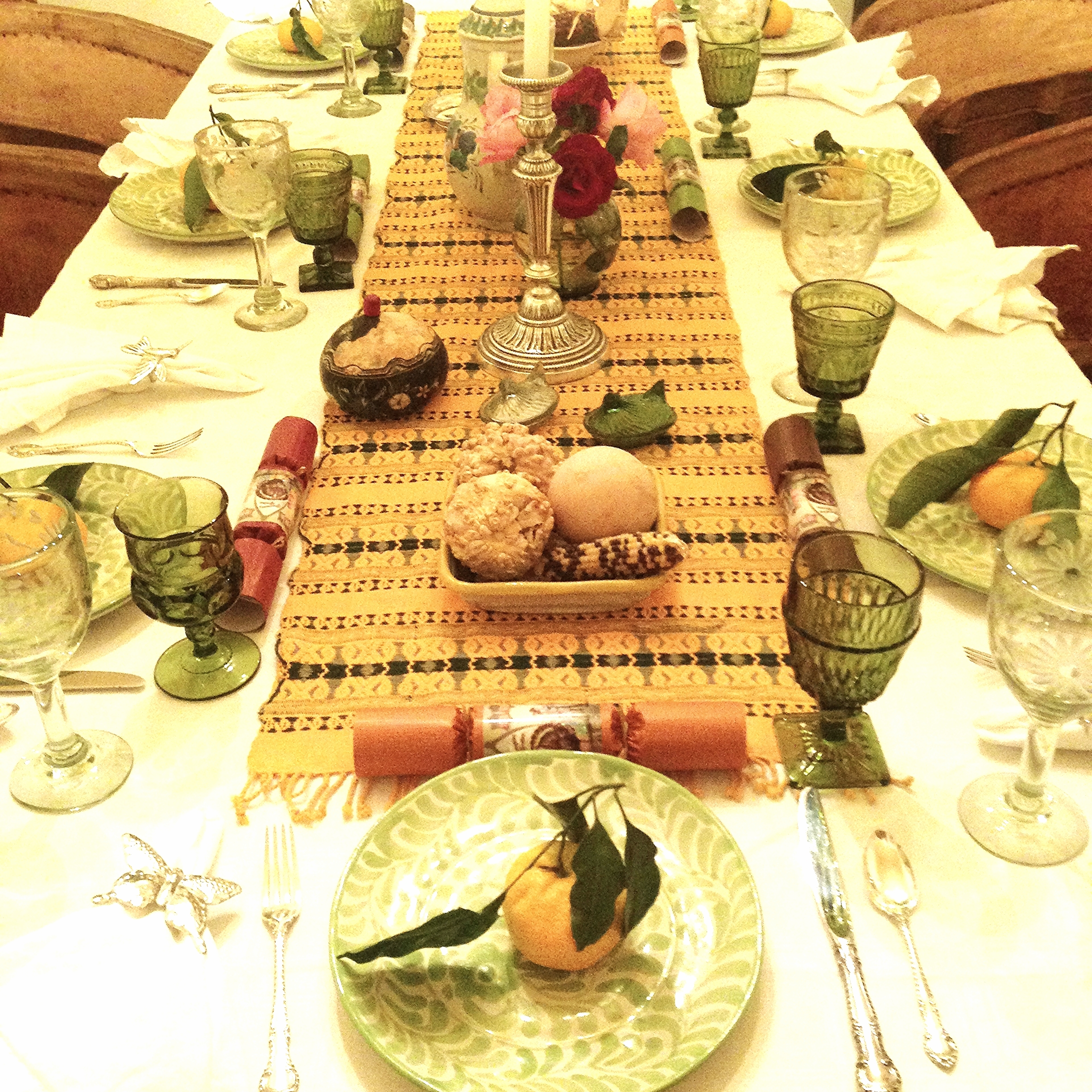 Our annual table includes many Mexican influences, from the dishes to pottery to glassware. Other touches are vintage or a nod to other cultures: poppers from England and tangerines originally inspired by a photo I found from Spain.