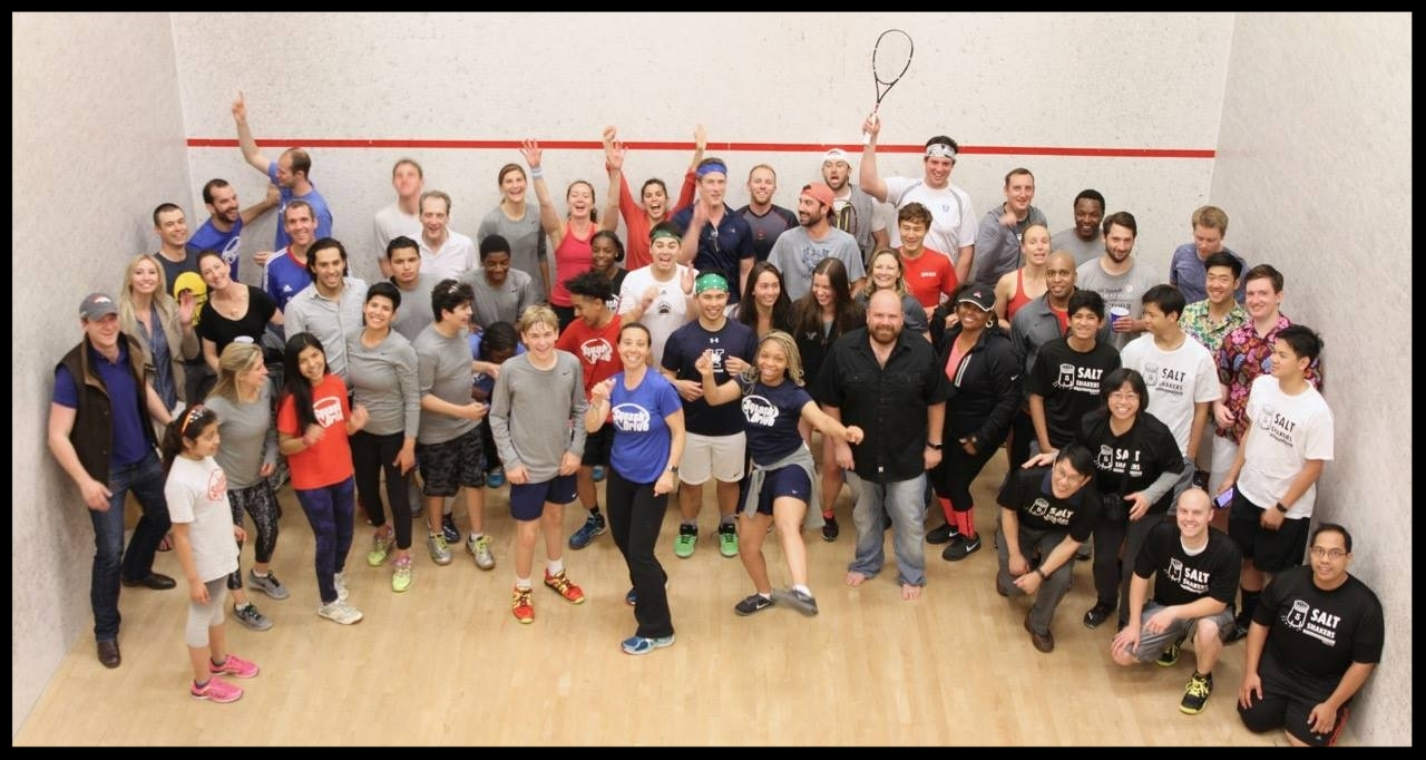 Lauren Patrizio Xaba  (center, blue shirt), Founder & Executive Director, with the  SquashDrive  staff, students and attendees at their annual fundraising event on May 11, 2017.(Photo Courtesy of Juliet Lamont.)