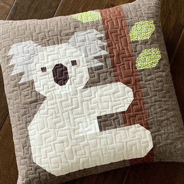 "Because my blocks can take a while to make, I like to include pillow projects (just one block!) in my patterns whenever I can. This is the 20"" pillow cover from my new Koalas pattern, made with @robertkaufman basics and a print from my new Library collection. Pattern coming early November. #ehkoalasquilt"