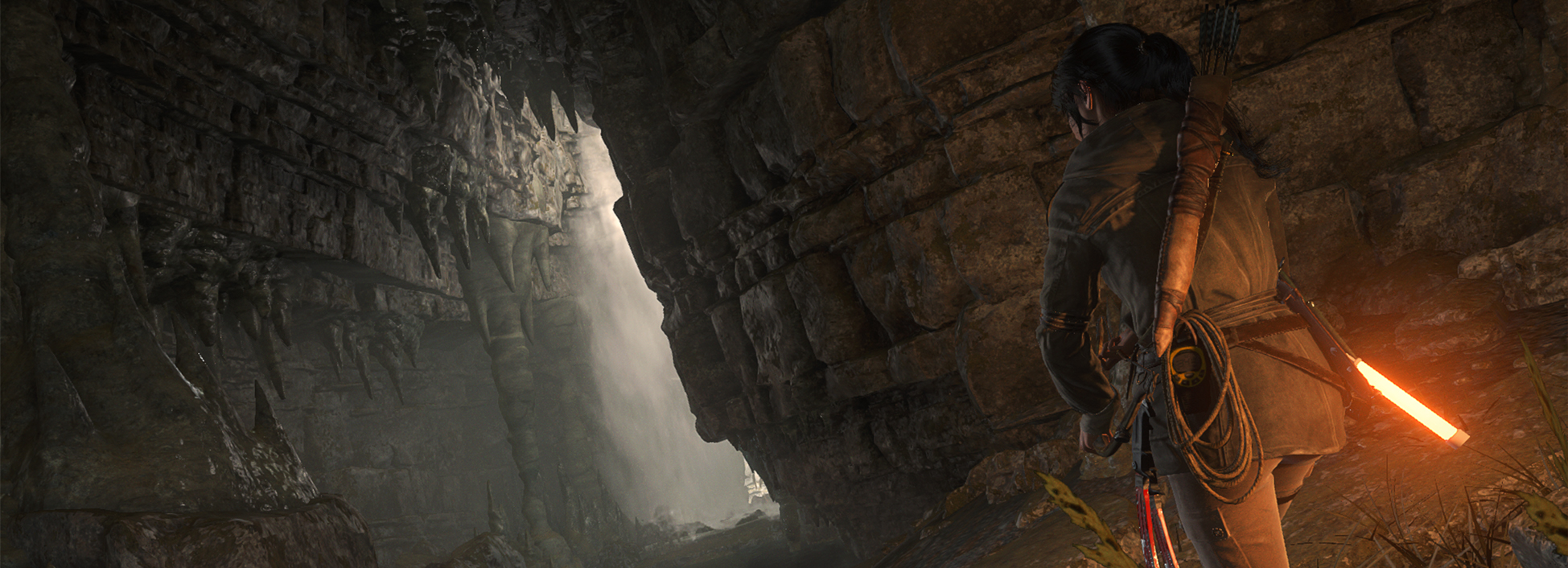 Lara Croft investigates cave in Rise of the Tomb Raider 2015