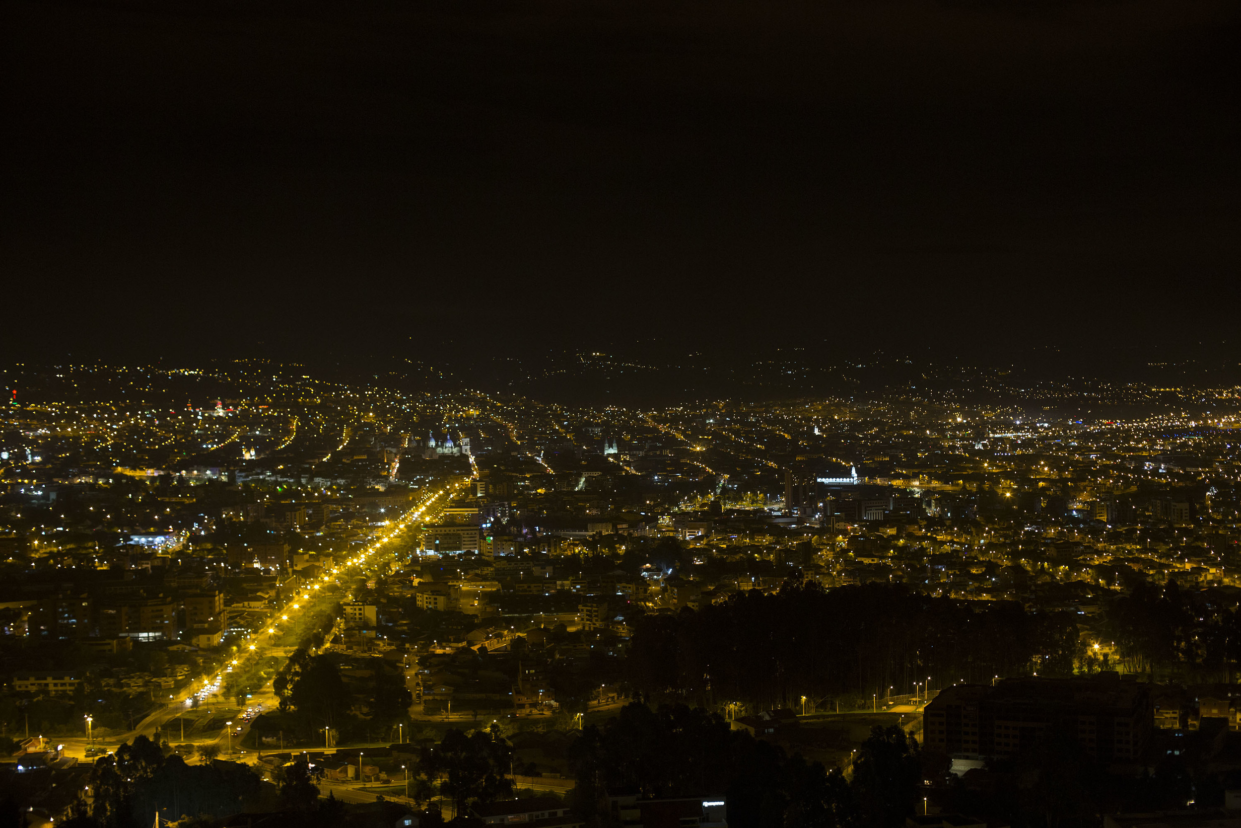 There are mountains arching up over those city lights, you just can't see them at night.