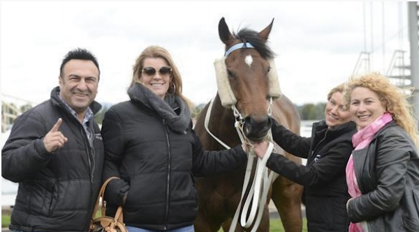 MAGNETTE Part-owners Dave Azzopardi, Shanyn Puddy and Joan Wakim celebrate another win with strapper Emma Hubert