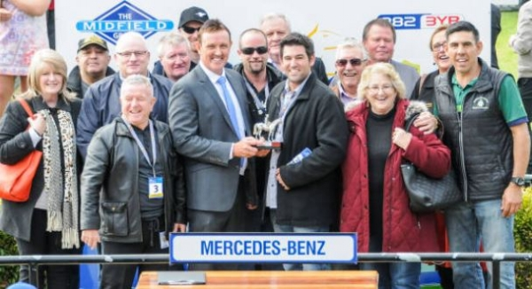 LENNY RUSSO ACCEPTS THE WINNER'S TROPHY AT THE 'BOOL