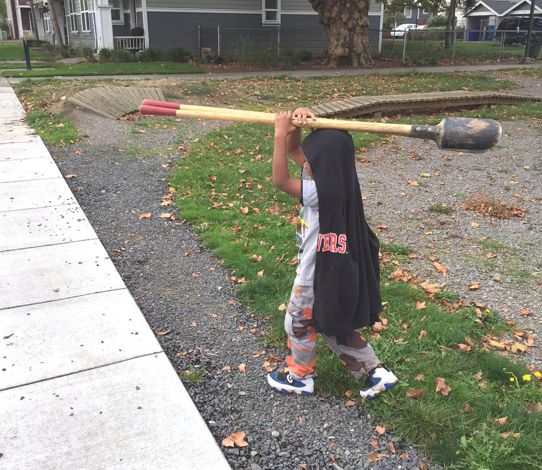 kid with tool.JPG