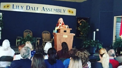 Psychic Medium Michelle Whitedove Lily Dale Event on stage.jpg