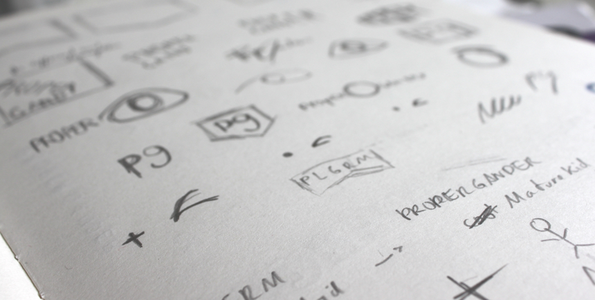 Detailed view of initial logo sketches