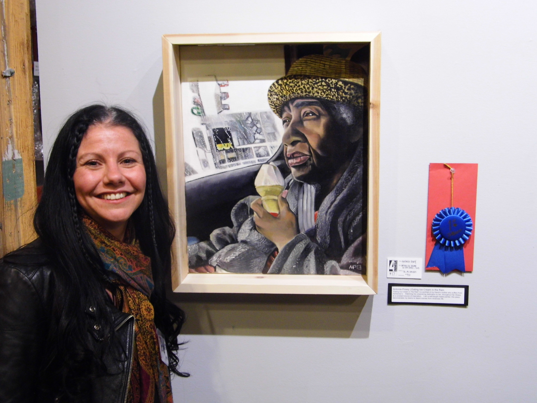 """Artist Antonia Posey with painting """"Eating Ice Cream in the Rain,"""" which took best of show at The Starline Gallery's 4th Fridays art exhibit in Harvard, Illinois, 2014."""