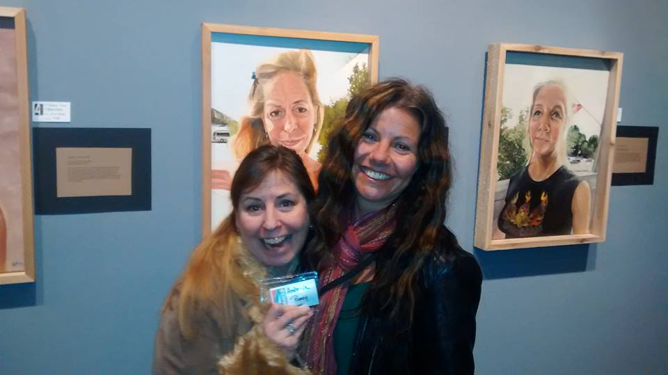 Artist, Antonia Posey, and Bonnie, standing in front of Bonnie's portrait, America the Working Poor, Portrait of Bonnie-Boo, 2014.