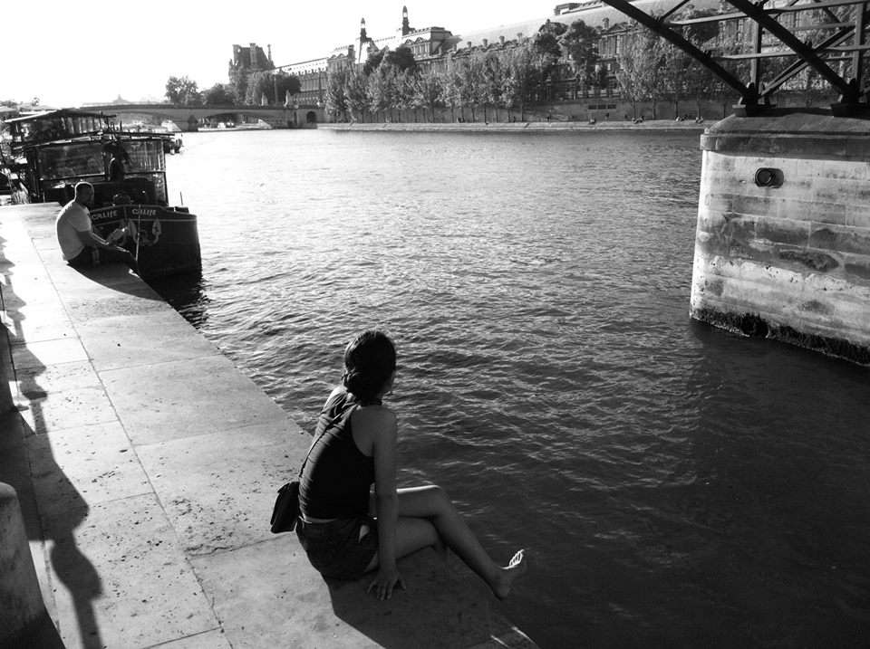 Watching the world go by at the Seine. Photo by Brian Carroll
