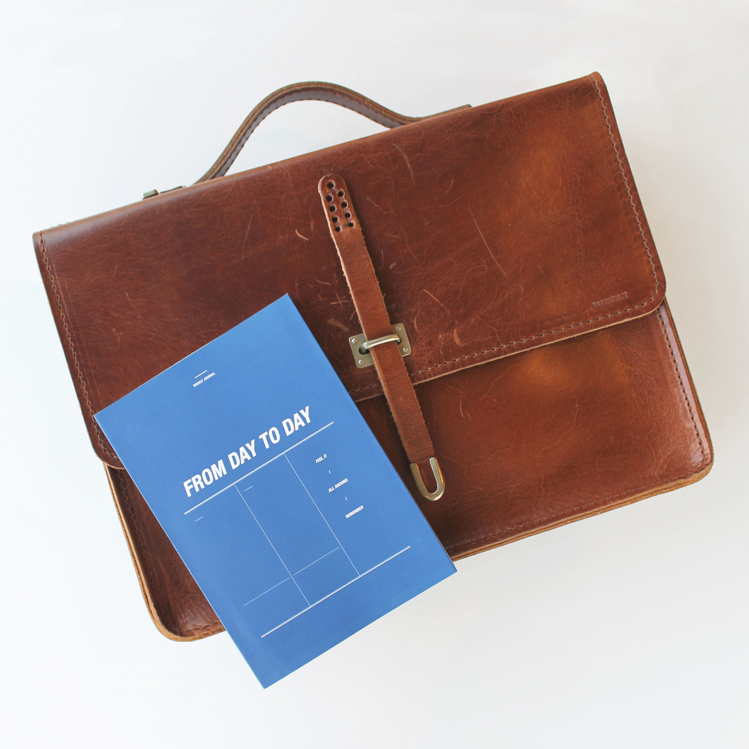 Schoolboy Satchel  +  Day to Day Planner    - He works hard and should look good doing it.