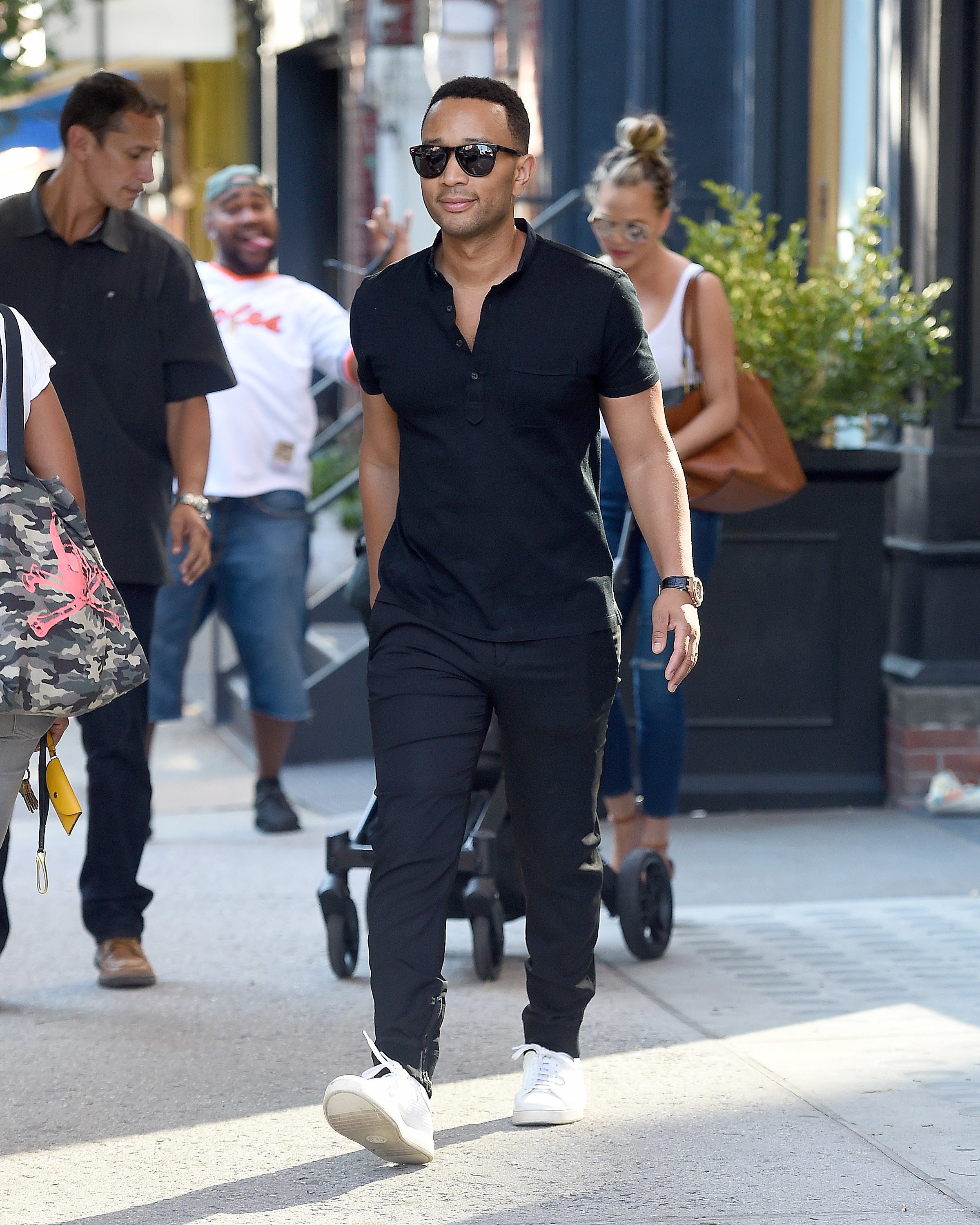 While John Legend was smart to forgo dad jeans for far cooler chinos with an unexpected exposed zipper hem details, featuring his Tom Ford sneakers