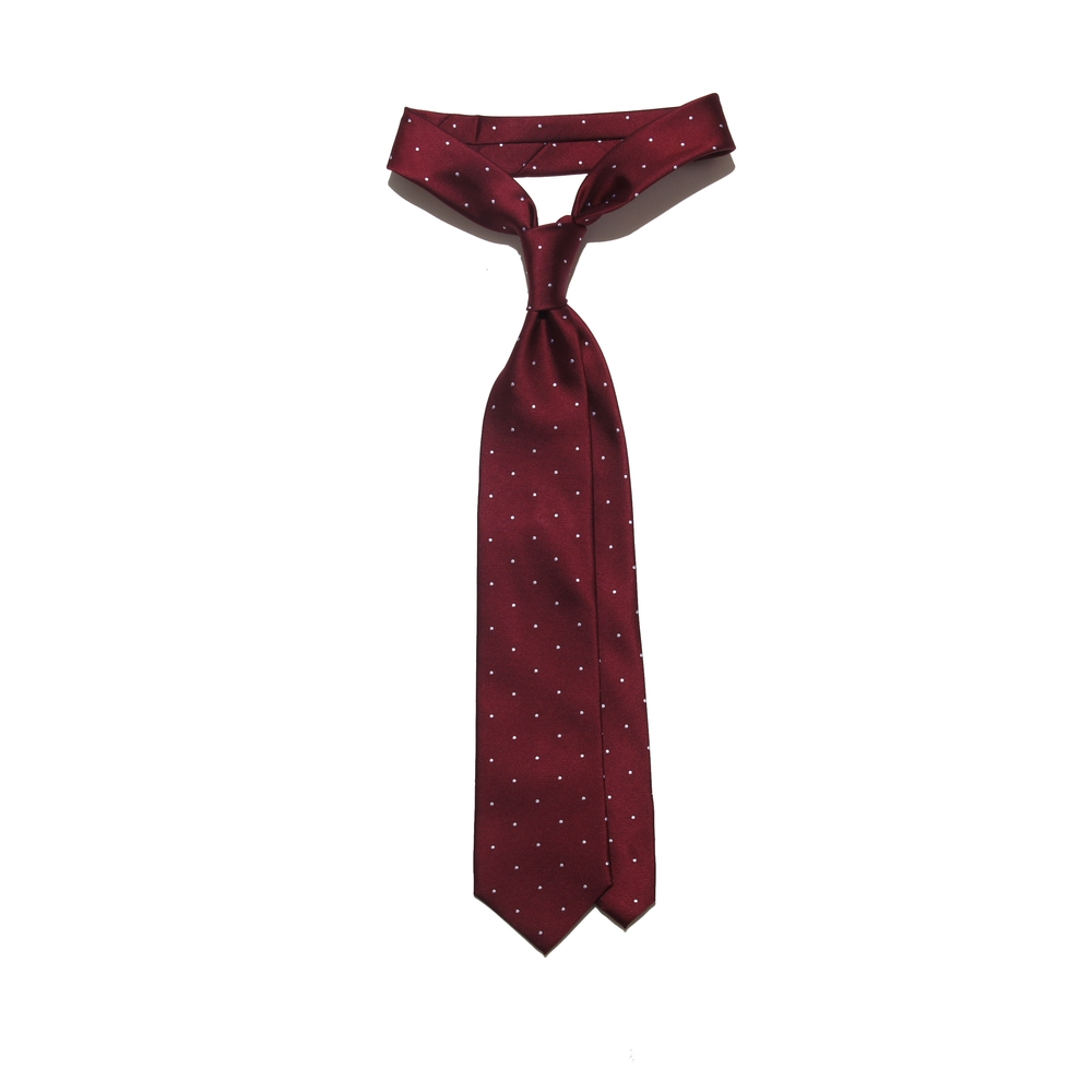#2 Simple Tie - With a minimal print or pattern, a simplistic tie matches well with any array of suit combinations and textures.
