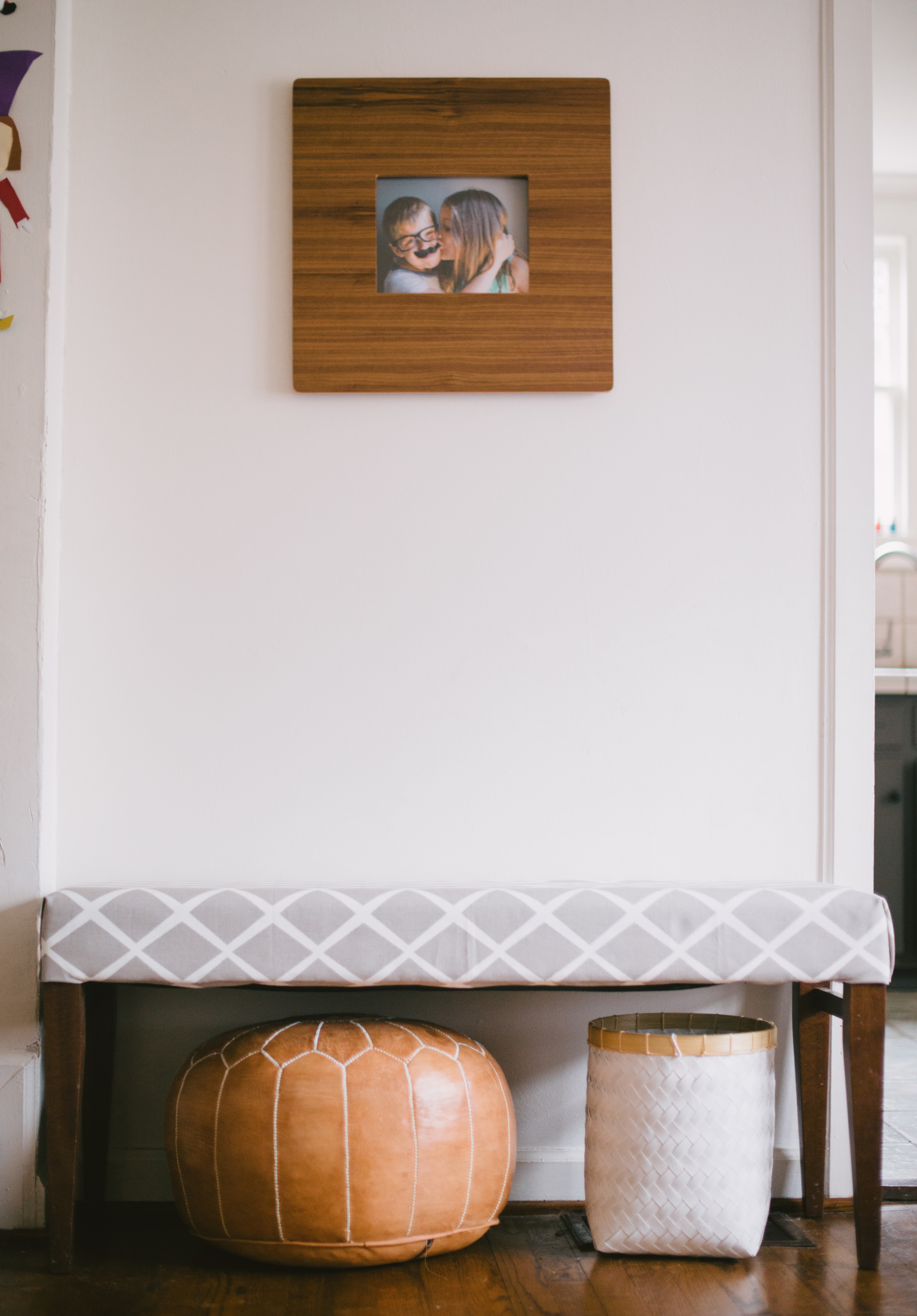 Sources:  fabric:  Serena and Lily  | pouf { similar } | frame: Room and Board | basket: Homegoods { similar } | wall color: talc by Martha Stewart for Home Depot