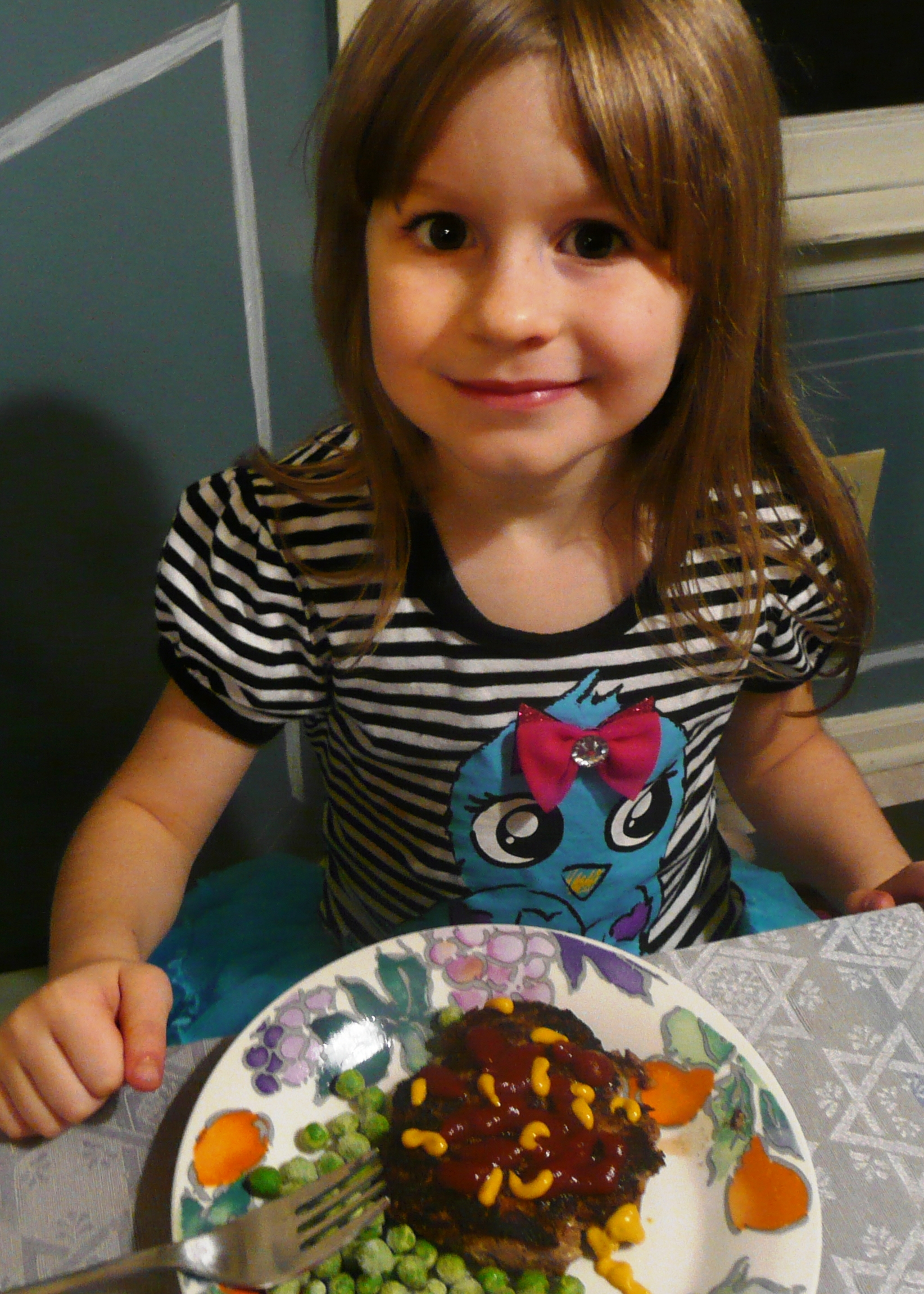 This is my beautiful girl and she told me she decorated her burger like a fish tank! Of course!