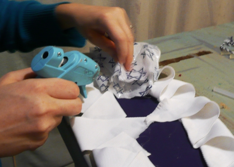 Adding more fabric! it reallyis all about the glue!