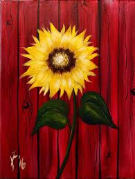 Sunflower against red barn.jpeg